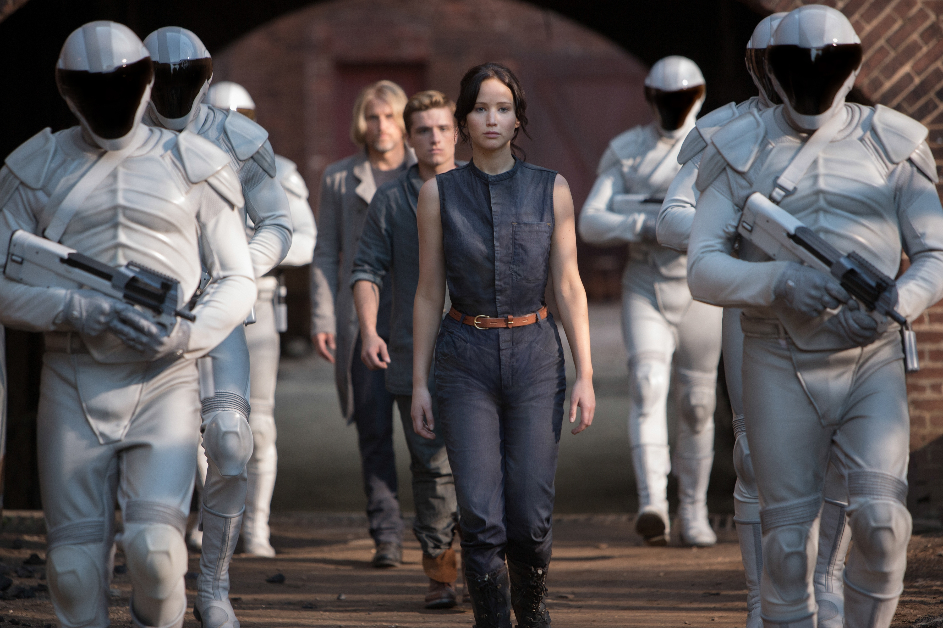 """Jennifer Lawrence as Katniss Everdeen, from foreground to background, Josh Hutcherson as Peeta Mellark and Woody Harrelson as Haymitch Abernathy in """"The Hunger Games: Catching Fire."""""""