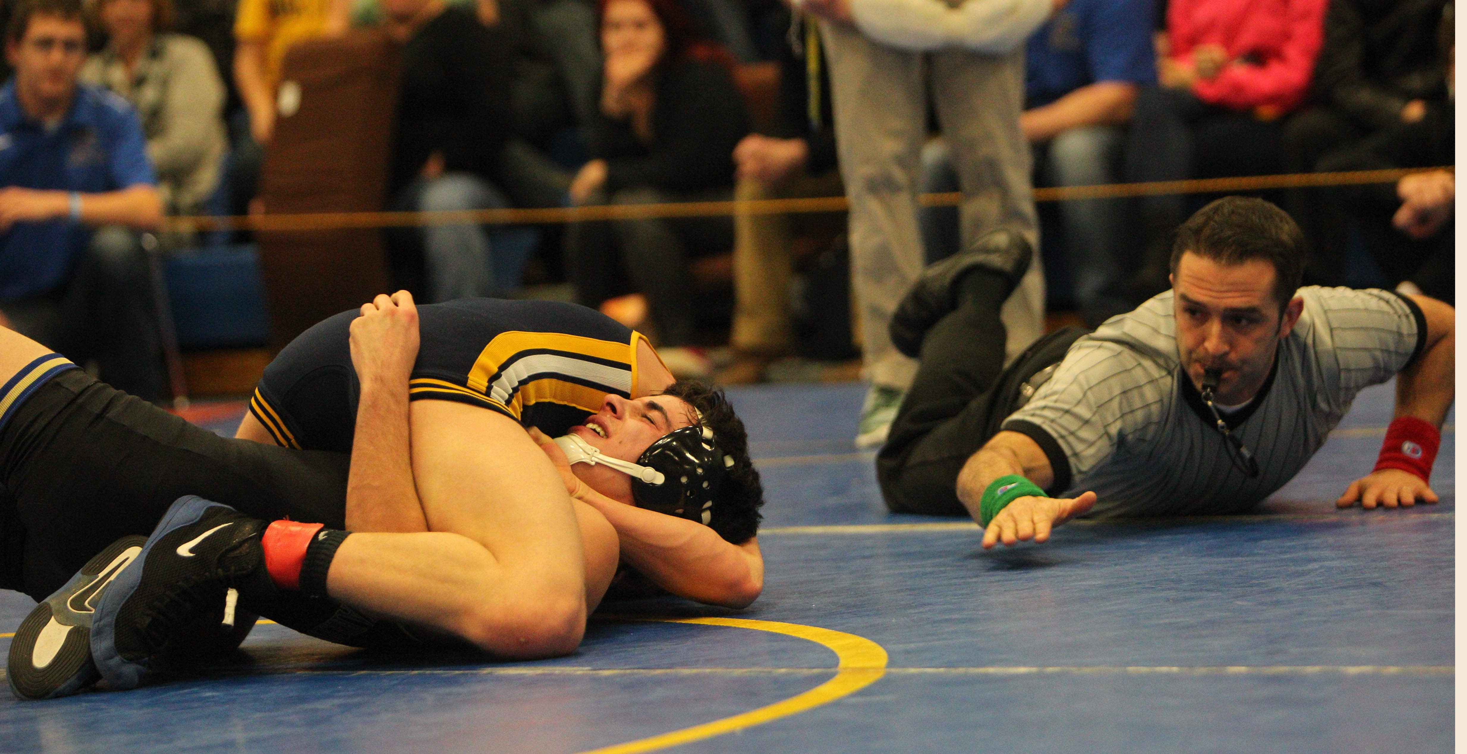 Anthony Orefice of Lockport scores a pin against Tommy Lancie of Webster-Schroeder just seconds before the end of their championship match in the 126-pound class of the Niagara Frontiers Officials meet.