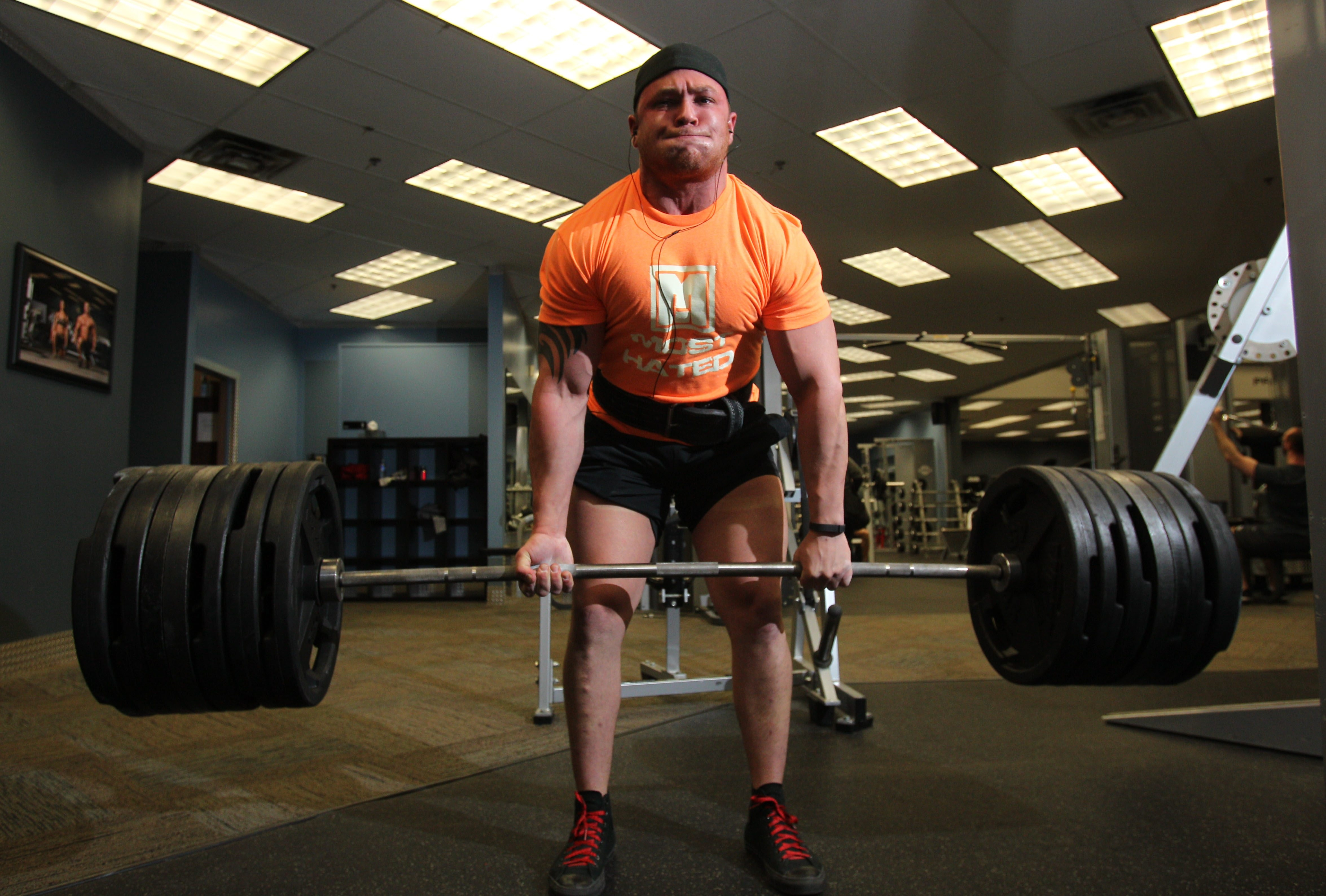 Luigi Fagiani of Niagara Falls trains at Primerano Fitness on Monday. During his session, the 23-year-old powerlifter worked up to lifting 745 pounds. Fagiani recently set records for his age and weight class.