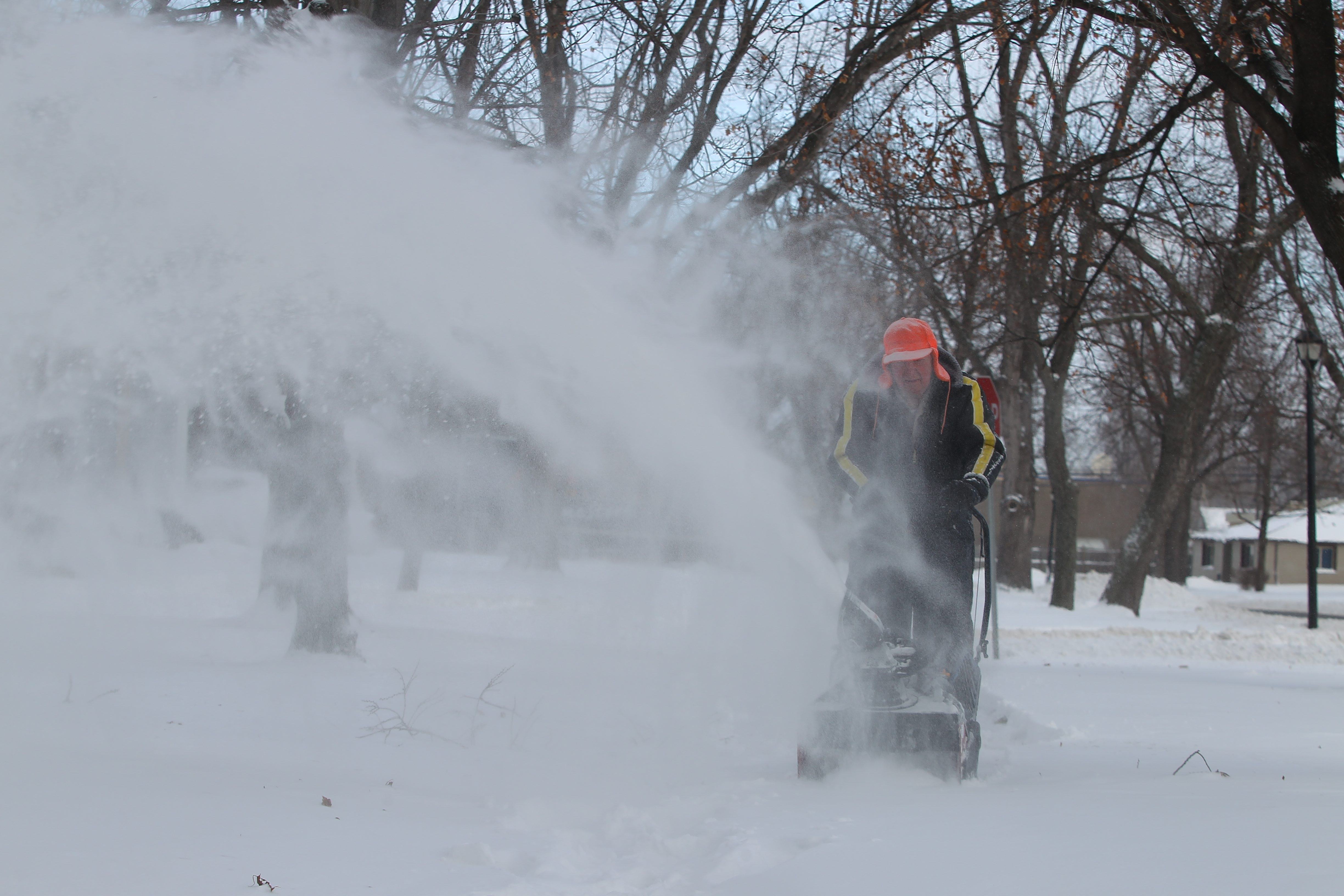 Chet Sheppard uses a snowblower at his home in the Town of Tonawanda today.