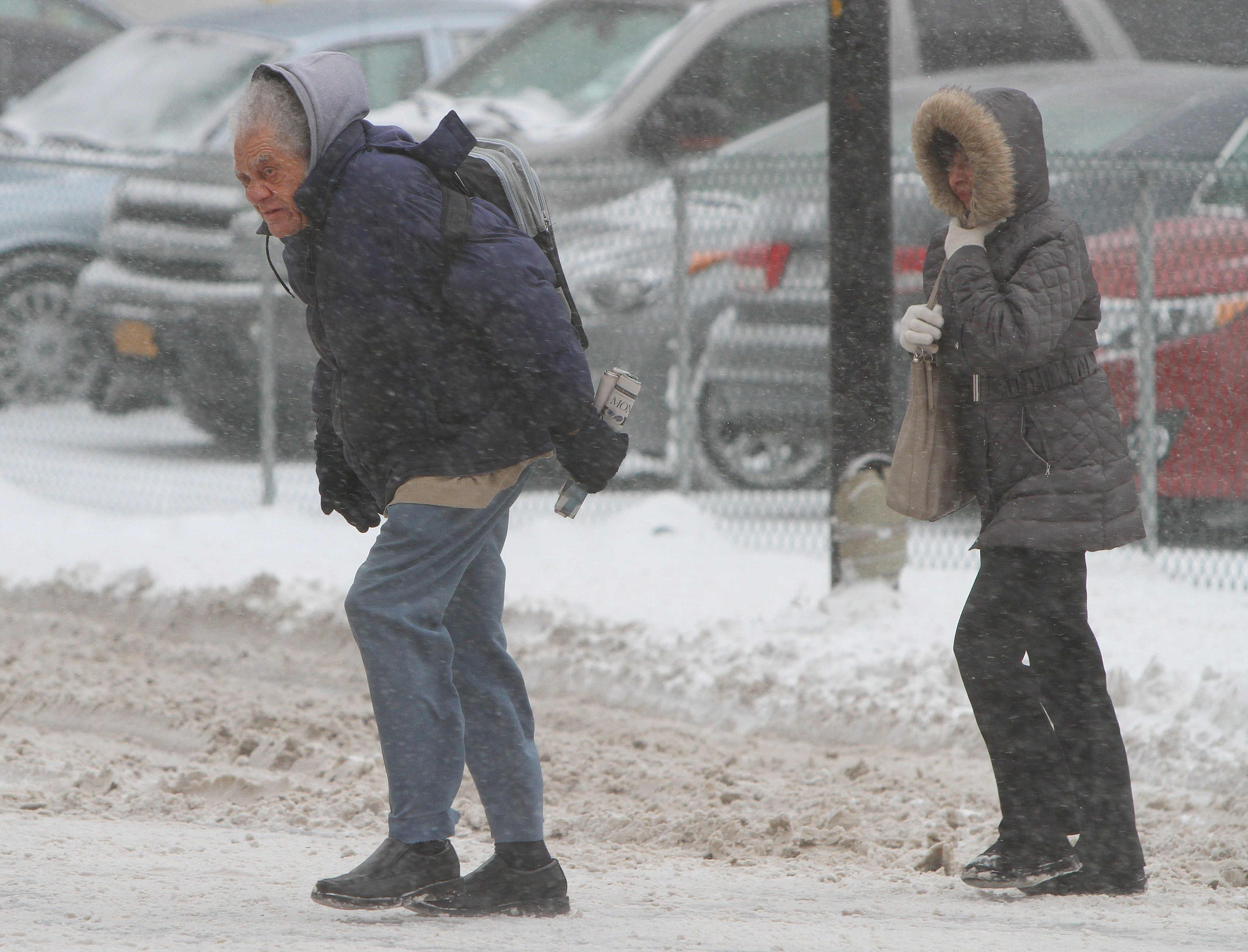 Walkers brave the cold and snow on Pearl Street in Buffalo on Thursday.