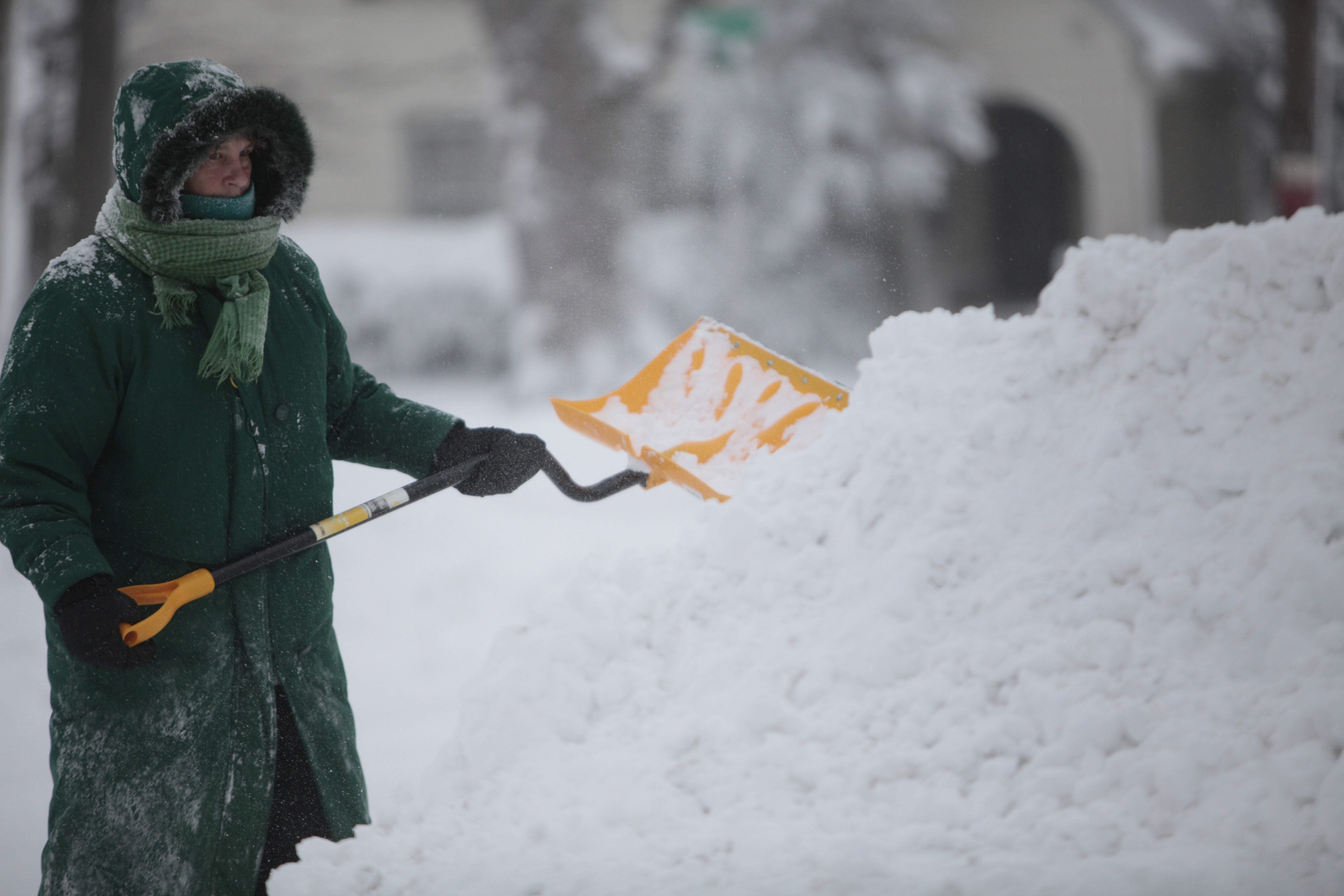 Candace Hines shovels snow on Center Street in the Village of Hamburg.