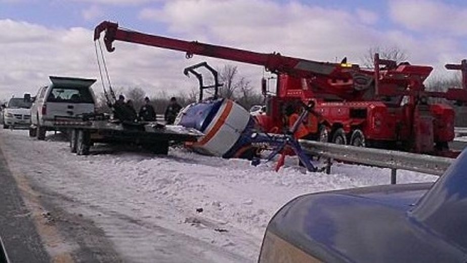 Photo provided by the State Police shows the accident scene in Pembroke today when a tractor trailer hauling a Mercy Flight helicopter rolled over on the Thruway.