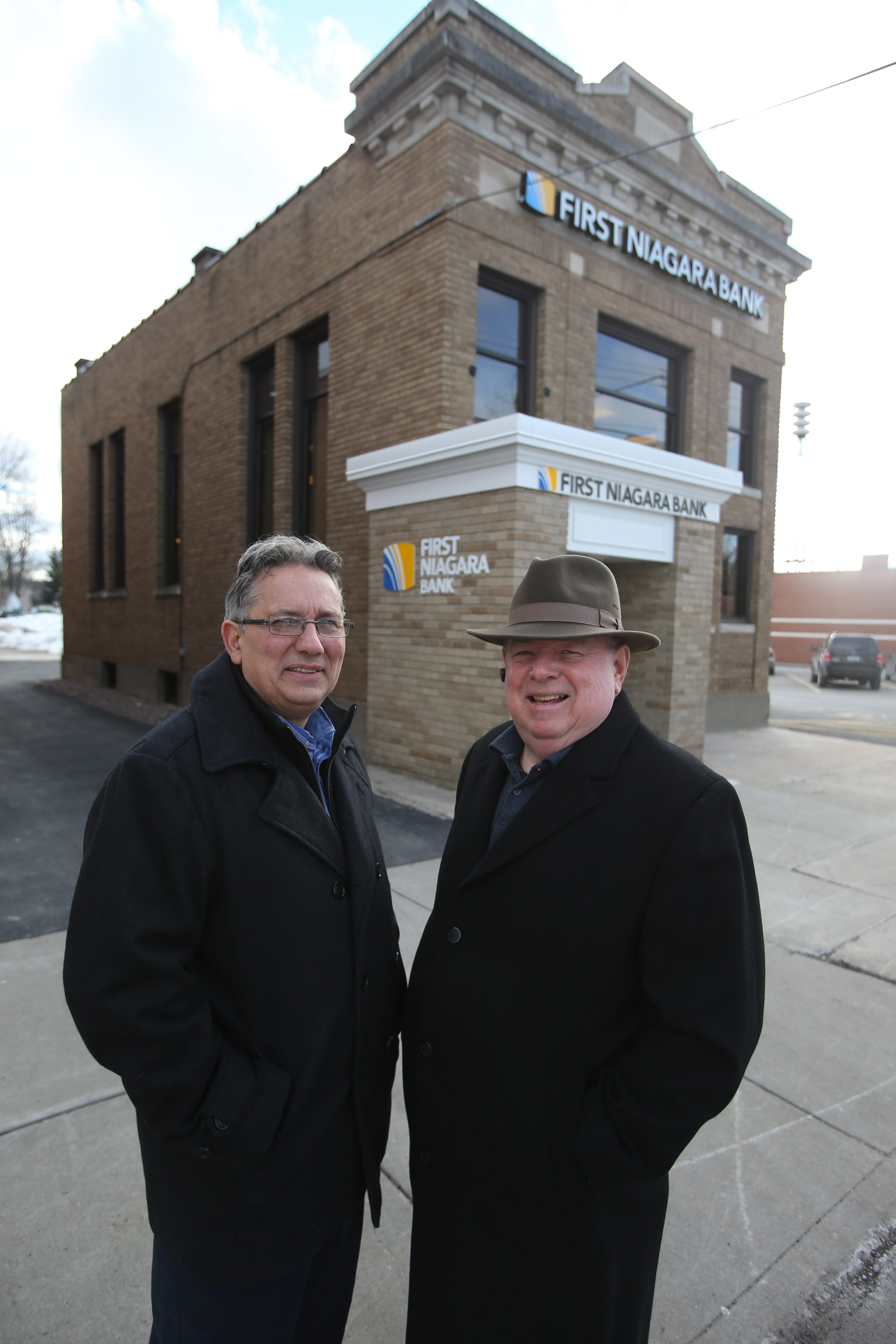 Wilson Mayor Bernard Leiker, left, and Phil Russell, president of Wilson Business Association, are trying to find another financial institution to move into the building.