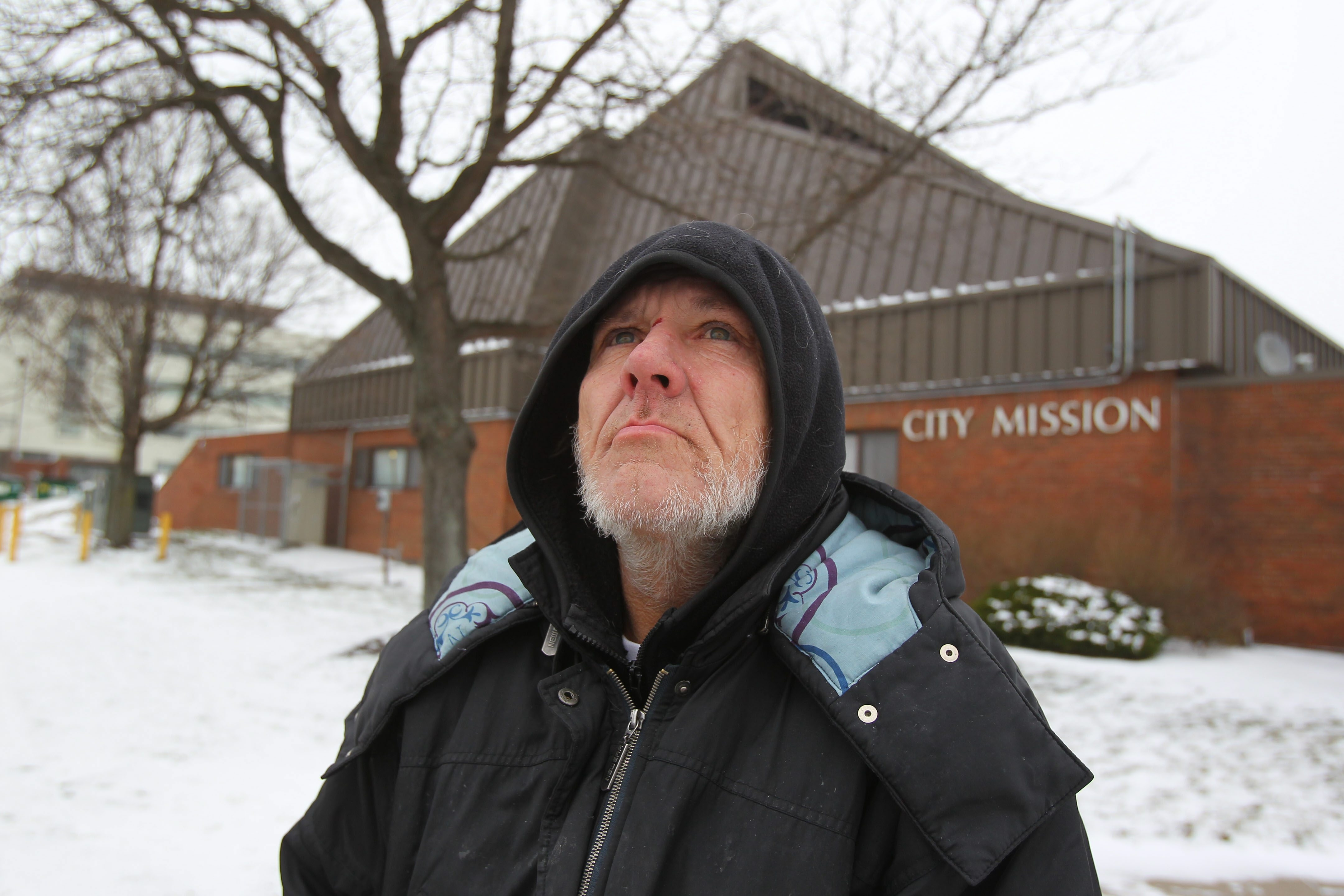 Niagara Falls native Kelly Foster stands in front of the City Misson, where he has stayed the last few nights because of the bitter cold temperatures. Foster said he has been homeless for about five years.