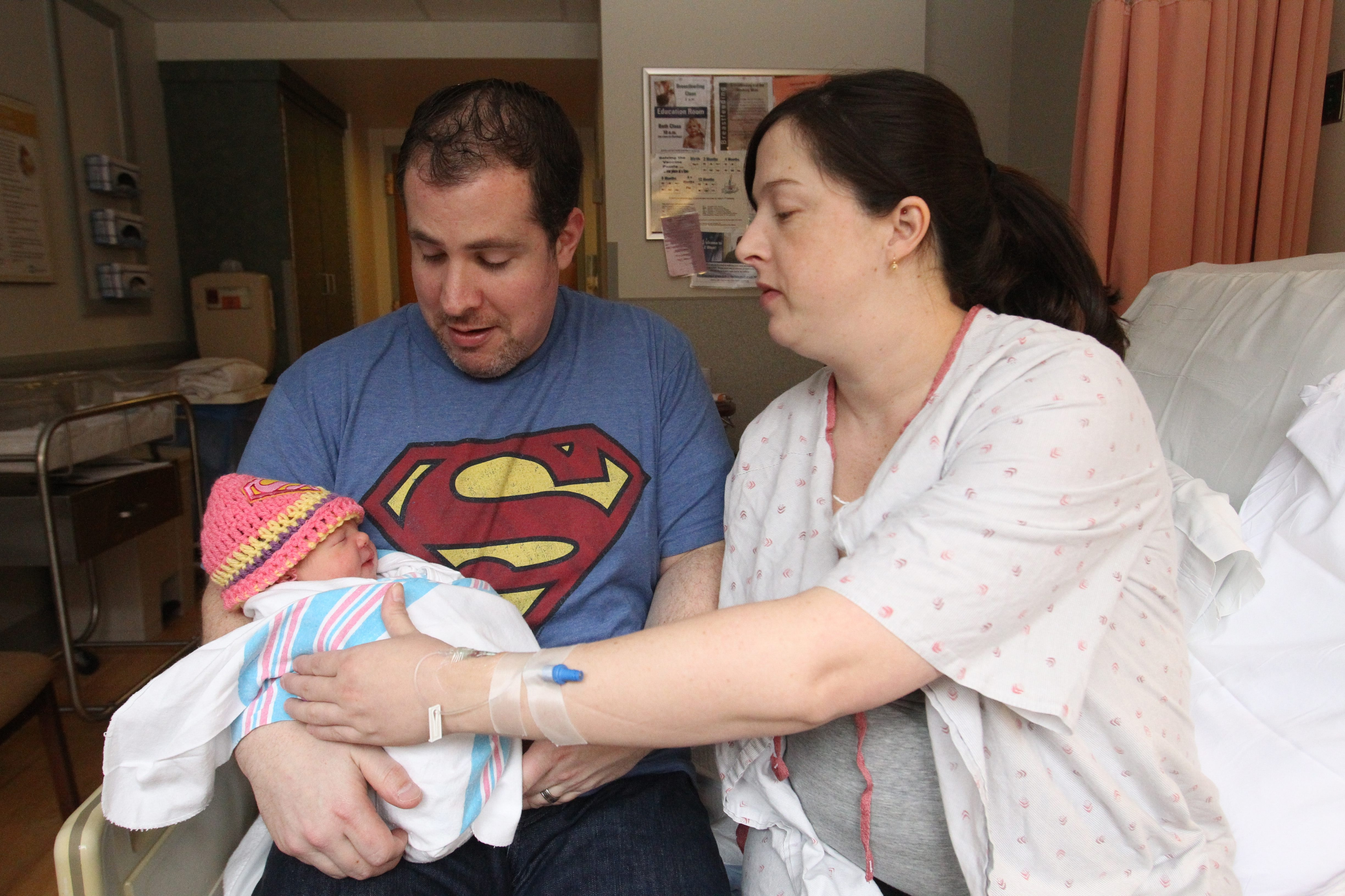 Chuck Amadori and his wife, Tracy, of Grand Island admire their new daughter, Lilliana Rose, born at 12:56 a.m. Wednesday in Millard Fillmore Suburban Hospital.