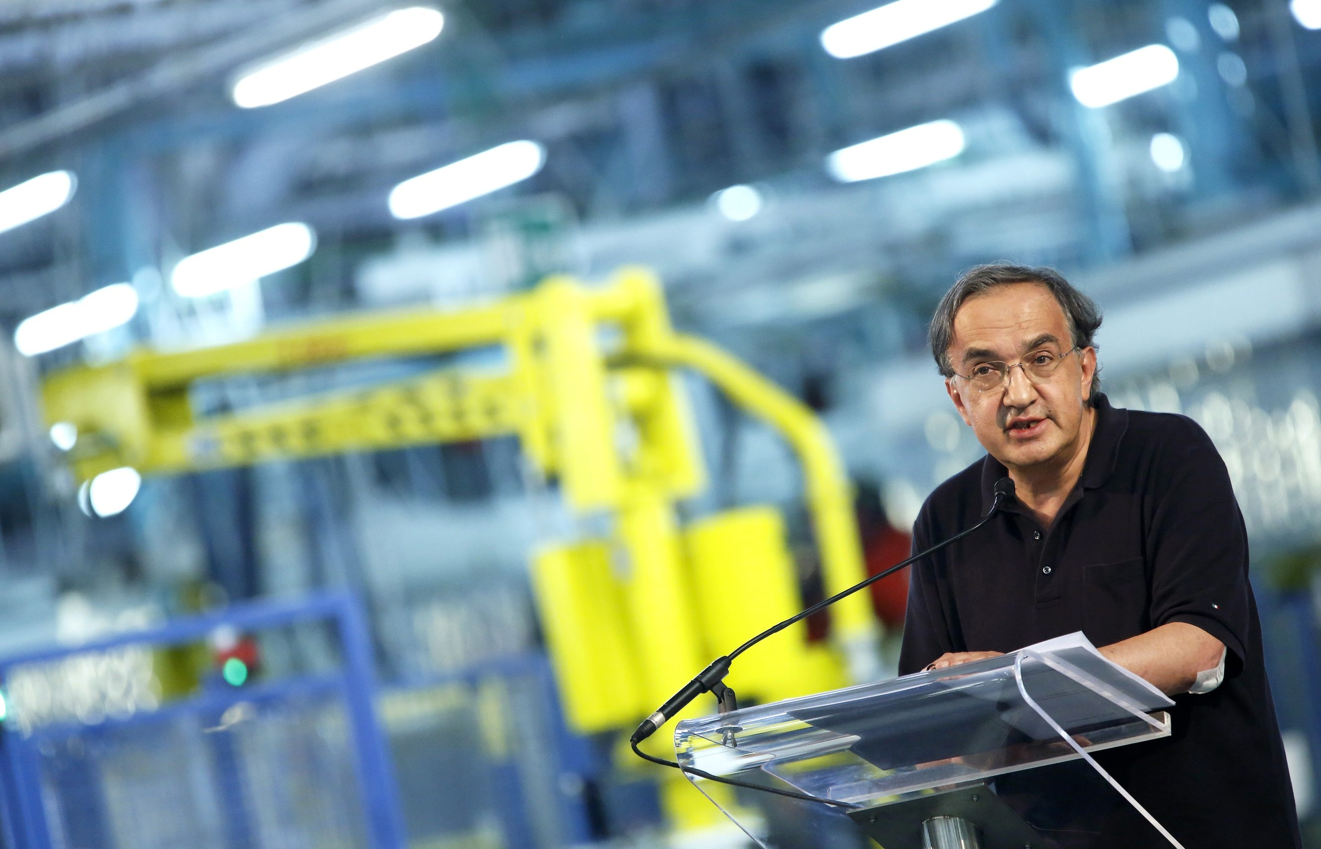 Sergio Marchionne, chief executive officer of Fiat SpA, speaks to employees on the production line at the SevelSud van manufacturing plant in Val Di Sangro, near Atessa, Italy, in July.  Marchionne has struck a deal to buy a 41.5 percent stake in Chrysler held by the UAW, giving Fiat total control of the No. 3 U.S. automaker.