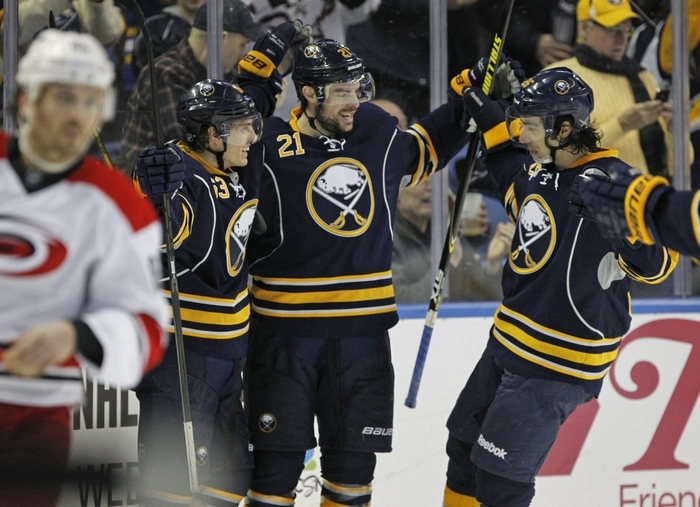 Tyler Ennis (63) celebrates his goal with Drew Stafford (21) and Matt Moulson in the third period against the Carolina Hurricanes. (Harry Scull Jr./Buffalo News)