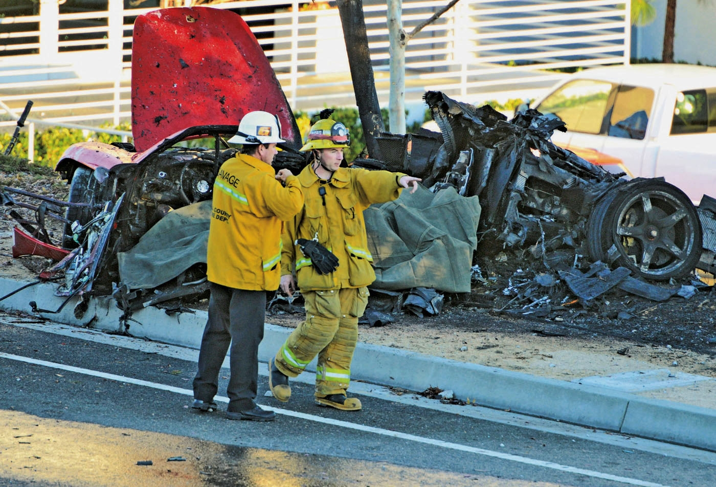 A coroner's report says the Porsche carrying Paul Walker may have been going 100 mph or more before it crashed.