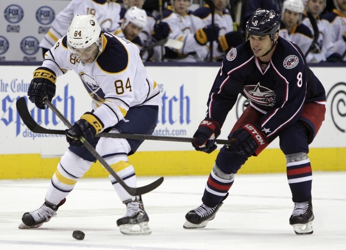 The Sabres' Phil Varone, left, skates away from Nathan Horton of the Blue Jackets. (Associated Press)