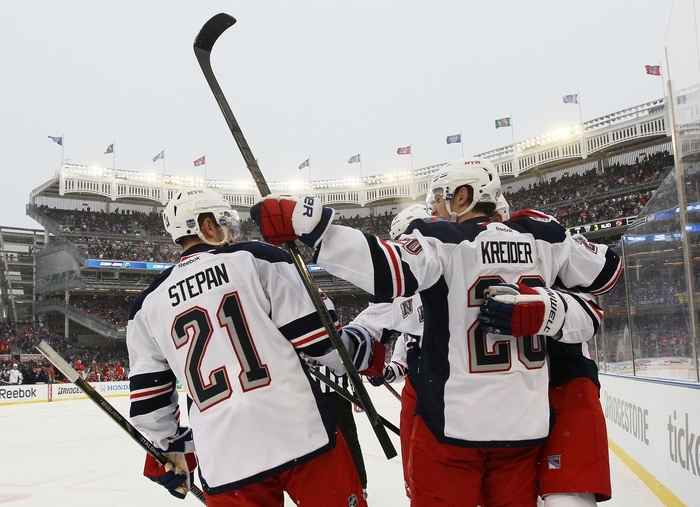 From left, Derek Stepan, Chris Kreider and Rick Nash of the Rangers celebrate Nash's second period goal against the Devils. (Getty Images)