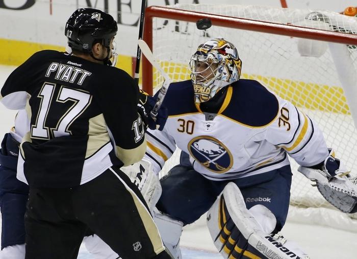 Penguins' Taylor Pyatt (17) watches a rebound from Sabres goalie Ryan Miller (30) on Monday. Pittsburgh won, 3-0. (Associated Press)