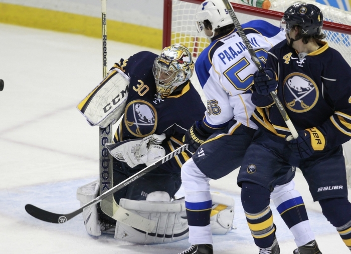 The Sabres' Ryan Miller keeps a shot from St. Louis player Magnus Paajavi during the third period Tuesday. (Harry Scull Jr./Buffalo News)
