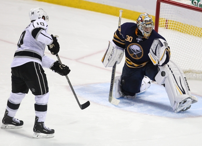 The Sabres' Ryan Miller stops the Kings' Mike Richards during the shootout Tuesday night. Miller stopped 43 shots in regulation and two more during the shootout to help the Sabres earn their first home win of the season.  (Mark Mulville/Buffalo News)