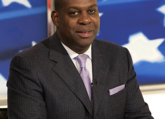 Kevin Cadle, a former basketball star at Baker-Victory, is one of the voices of the NFL for Sky Sports in Britain.