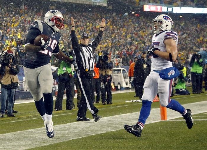 Patriots running back LeGarrette Blount scores a touchdown past Bills safety Jim Leonhard in the second quarter. (Associated Press)