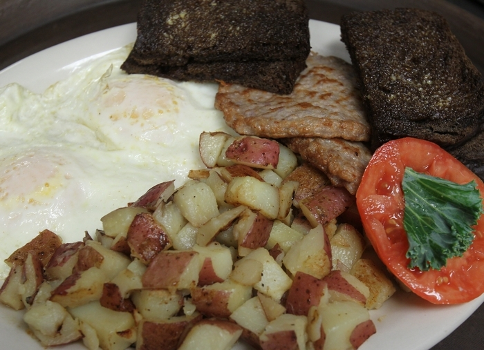This breakfast at Gordie Harper's Bazaar in Newfane features eggs, sausage, potatoes and toast. (Mark Mulville/Buffalo News)