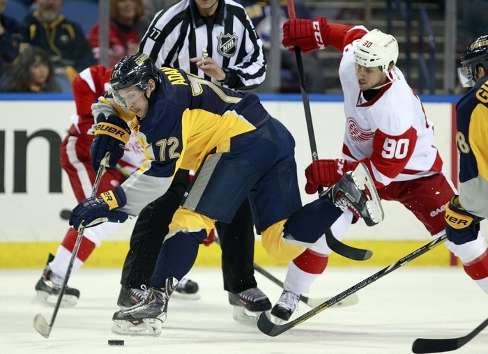 The Sabres' Luke Adam gets tripped by Detroit's Stephen Weiss during the third period. (Harry Scull Jr./Buffalo News)