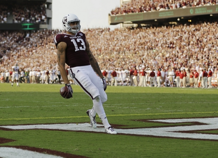 Texas A&M wide receiver Mike Evans, who is entering the draft as a sophomore, had 1,394 receiving yards this past season, catching 12 touchdown passes. Evans was a finalist for the Biletnikoff Award, given to the nation's top receiver. (Associated Press)