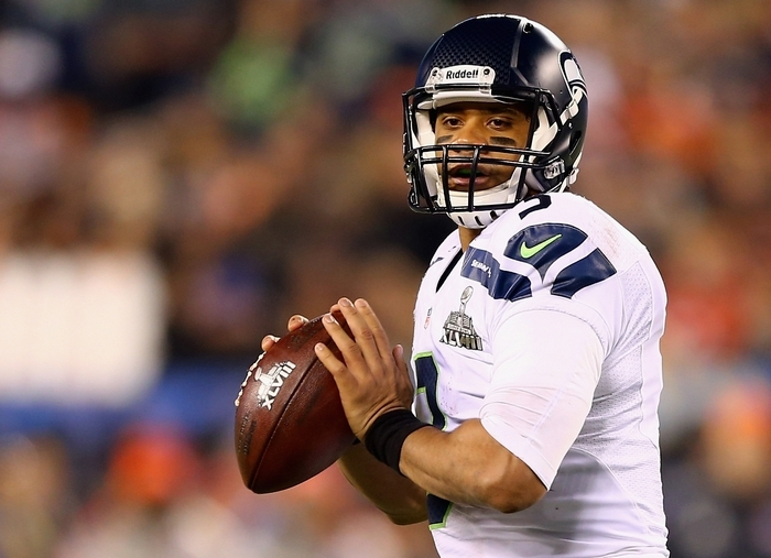 Quarterback Russell Wilson is a bargain for the Seahawks. (Getty Images)