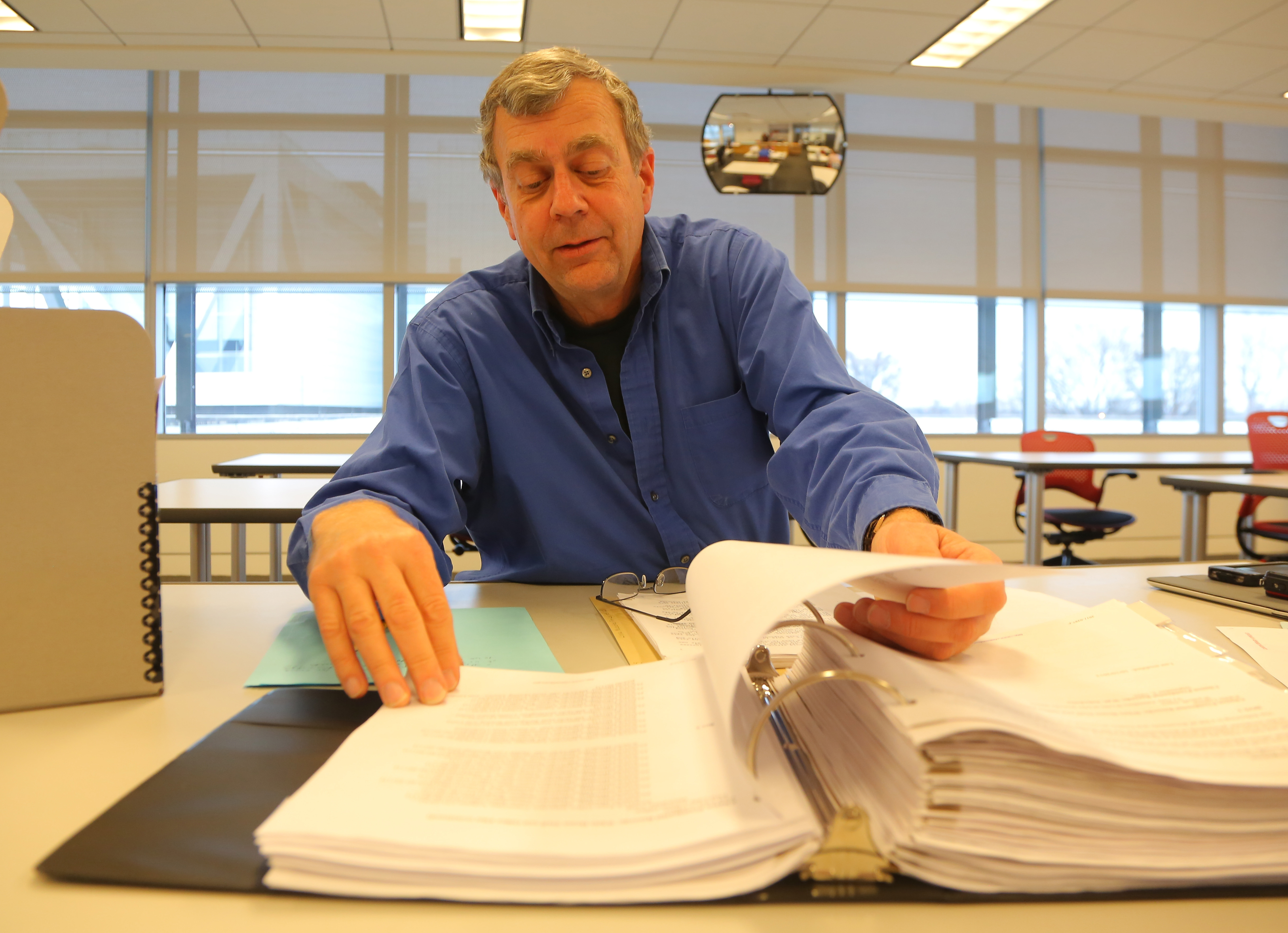 Ron Blome, a freelance news producer for NBC News, sorts through pages of Clinton administration documents inside a research room at the William J. Clinton Presidential Library and Museum after their release to the public on Friday.