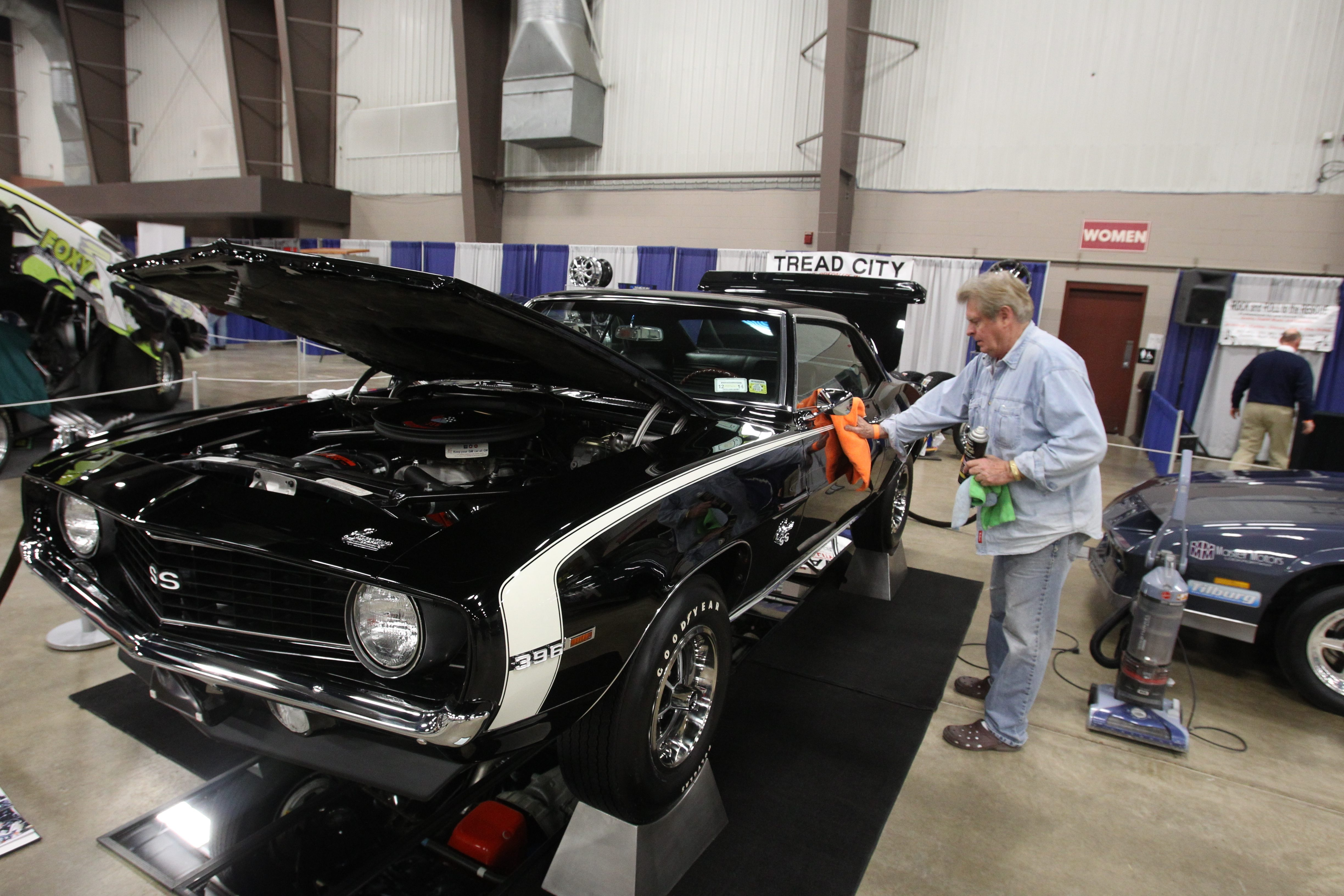 Jim Moonan, of West Seneca, cleans his 1969 Chevrolet Camaro SuperSport, which will be showcased this weekend at the Cavalcade of Cars show at the Fairgrounds  in Hamburg.