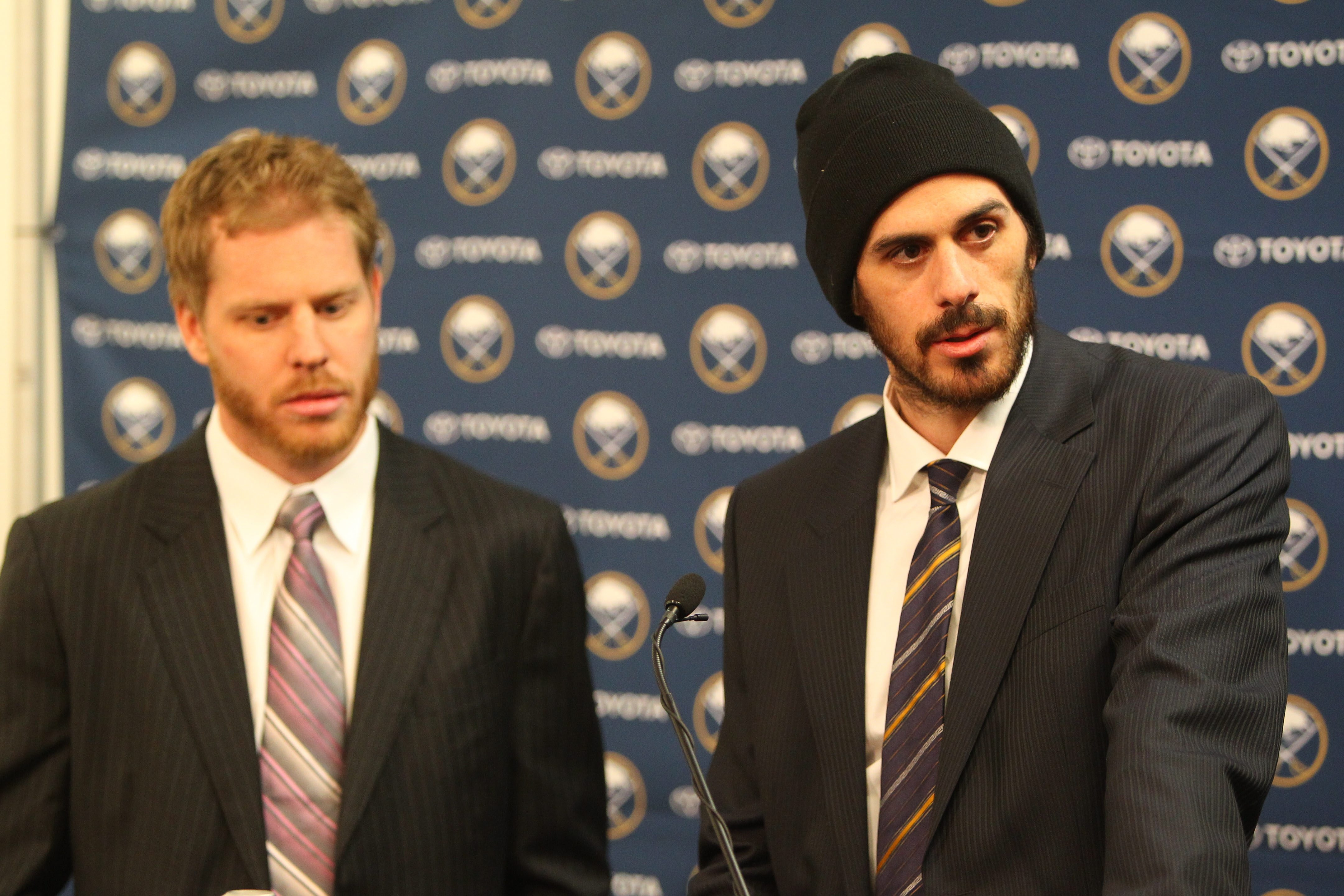 Ryan Miller, right,  and Steve Ott meet the media after being traded to St. Louis in First Niagara Center in Buffalo on Friday.