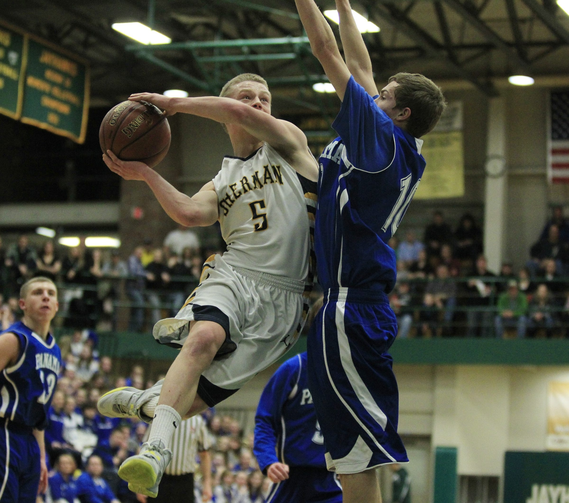 Sherman's Devin Moorhead (5) drives to the basket on Panama's Greg Delahoy (10) in the Class D final Friday.