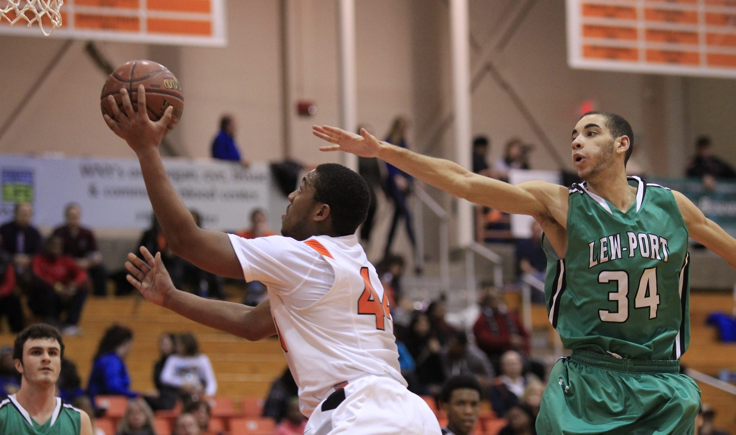 Darian Lowe of Amherst drives past Tyler Dietz of Lewiston-Porter during the Tigers' 51-49 victory.