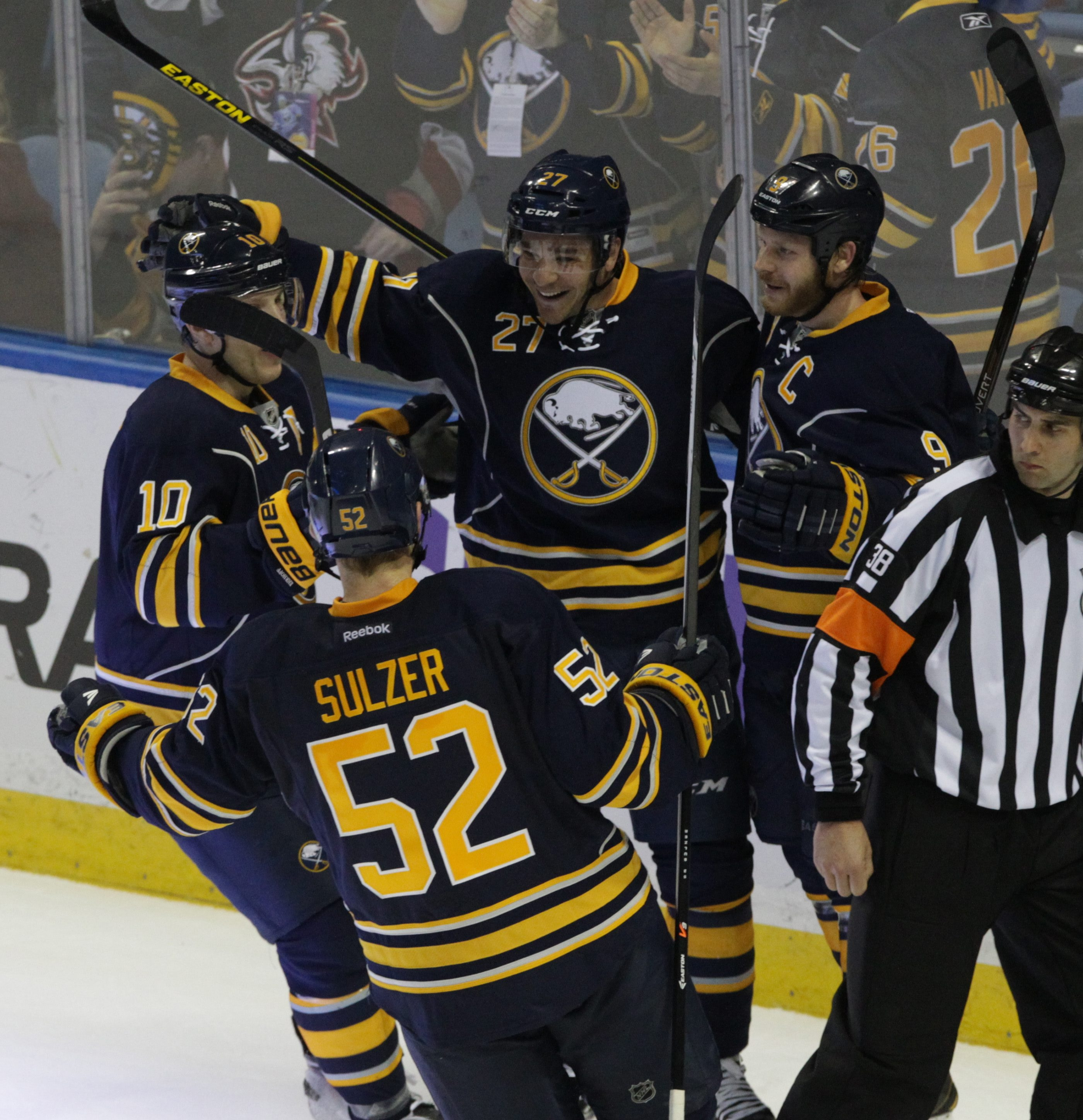 The Sabres' Matt D'Agostini (27) celebrates his game-winning goal in overtime after Matt Moulson tied it in regulation in Buffalo's 5-4 win. 5-4mwimn.
