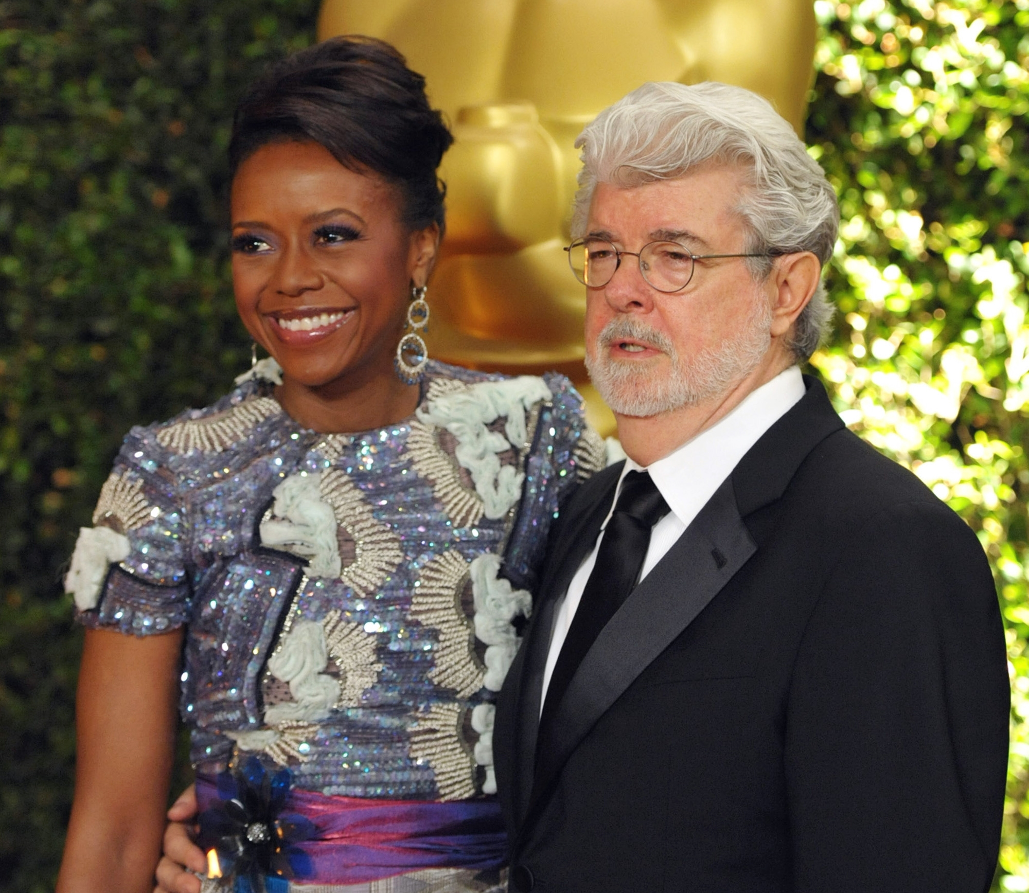 Filmmaker George Lucas and his wife, Mellody Hobson, are donating $25 million to build an arts hall at the University of Chicago's prestigious Laboratory Schools.
