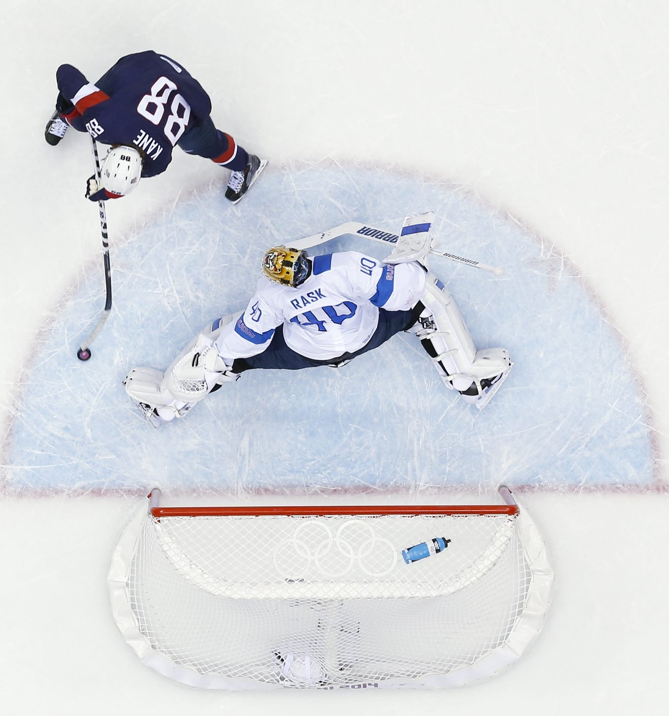 Finland goaltender Tuukka Rask blocks a penalty shot by U.S. forward Patrick Kane during the first period of Saturday's game.  Kane went 0 for 2 on penalty shots.