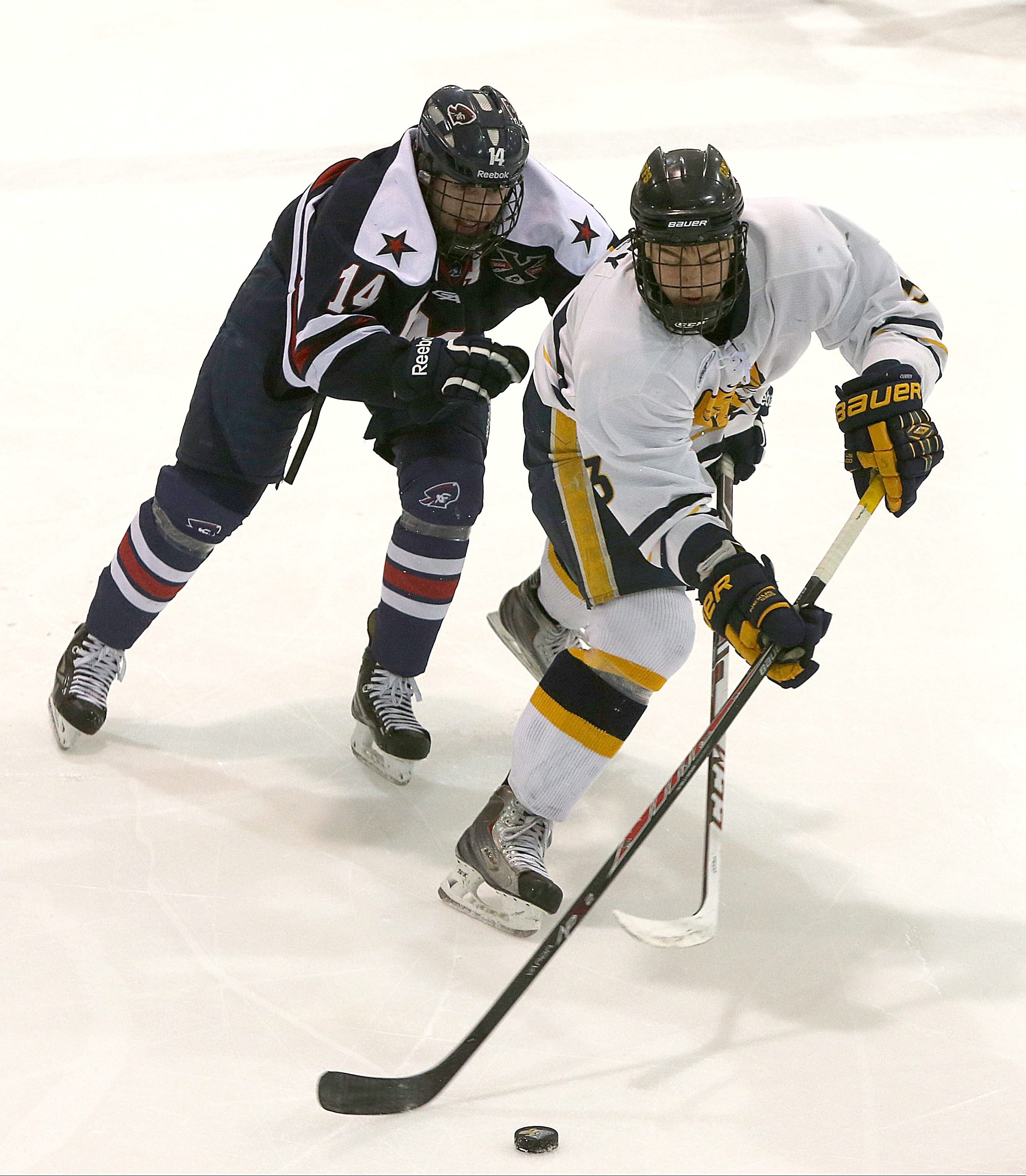 Doug Jessey of Canisius, right, and David Rigatti of Robert Morris battle in the third period.