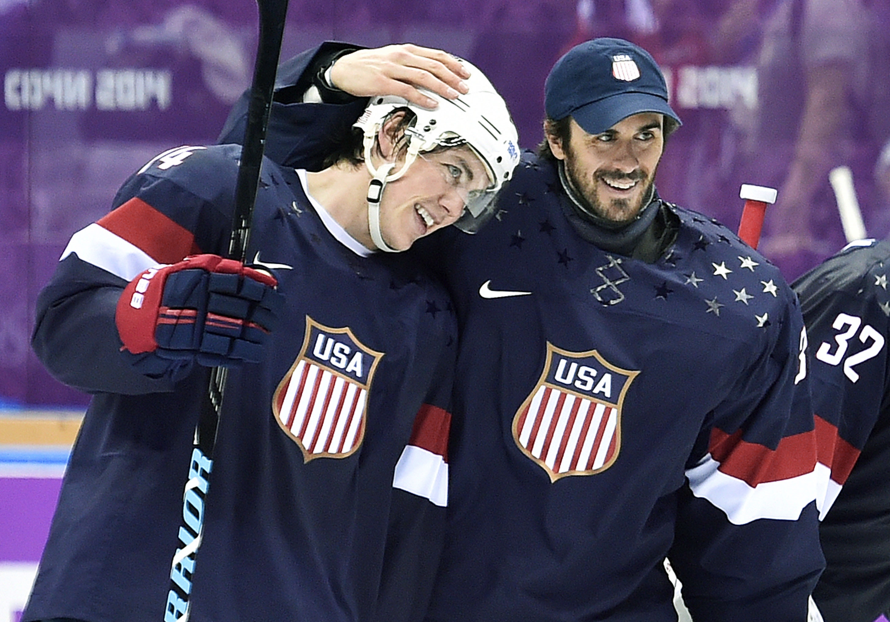 T.J. Oshie, left, is congratulated by Ryan Miller after Oshie's shootout winner for the U.S. against Russia last week at the Olympics.