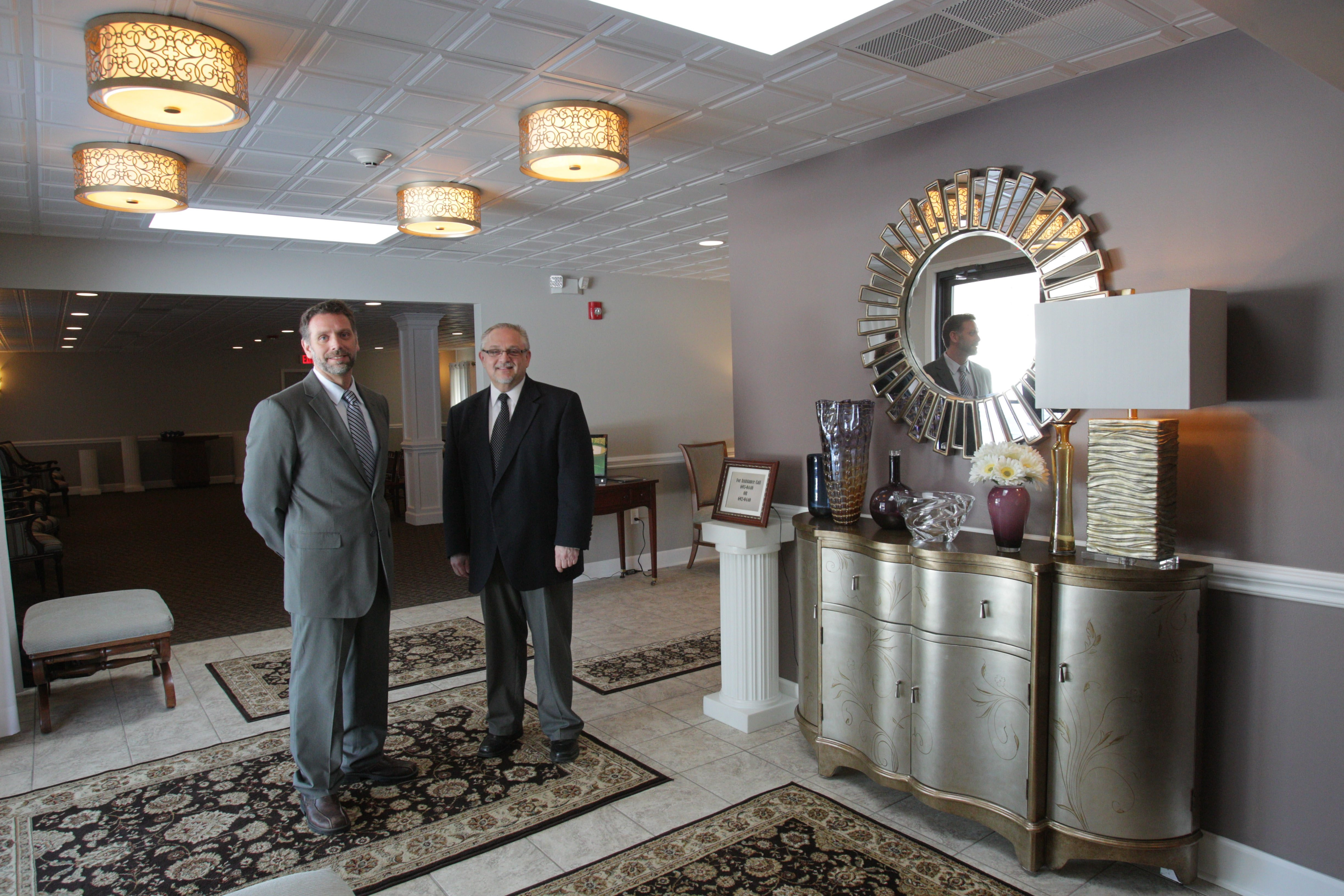 Wattengel Funeral Home directors Joseph V. Mantione, left, and Gregory M. Wood attend to details in foyer at newly opened second location on Meadow Drive in North Tonawanda. Grand opening is set for March 23.