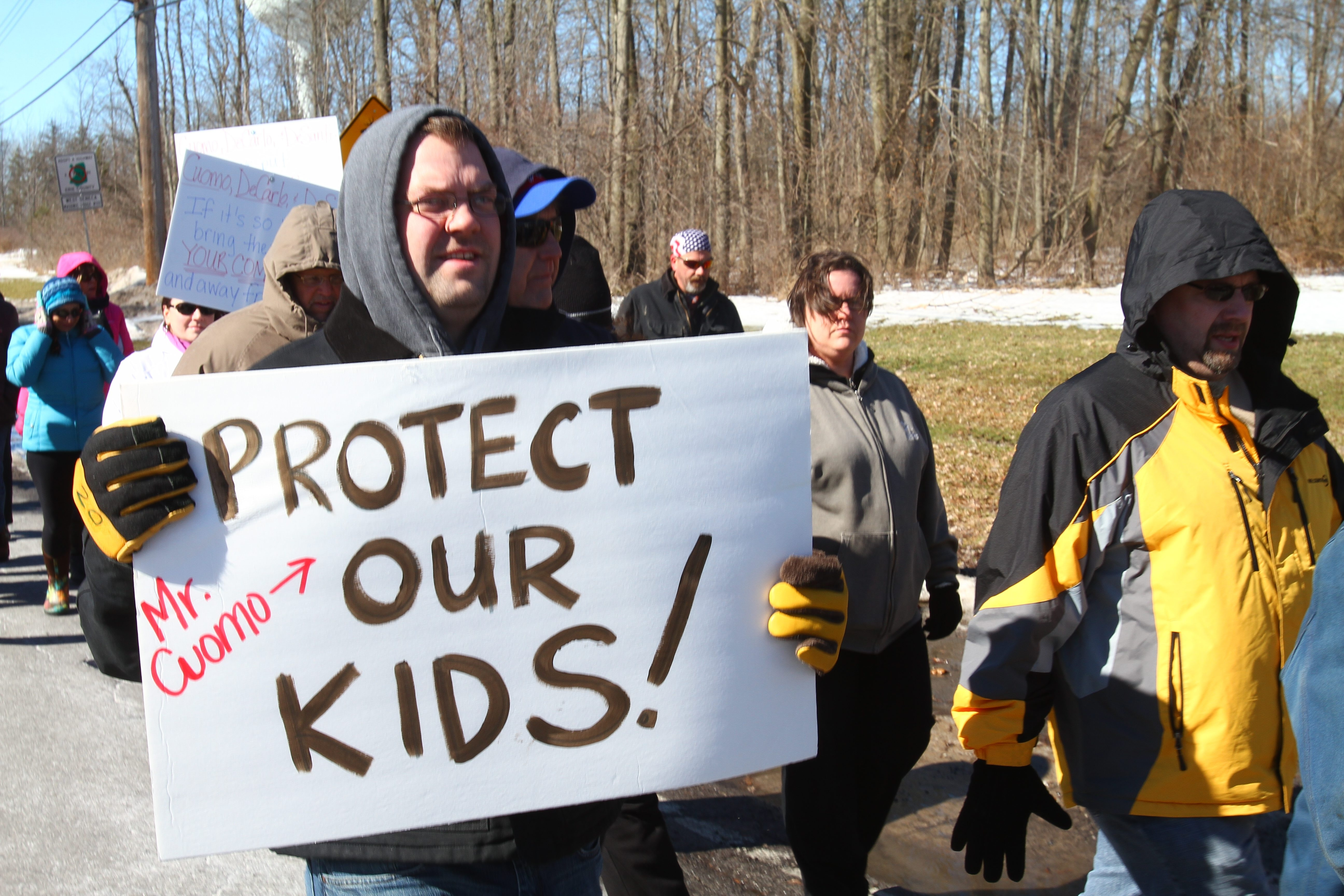 Residents march on Leydecker Road, West Seneca, in protest of sex offenders housed at group homes in the neighborhood. (John Hickey / Buffalo News)