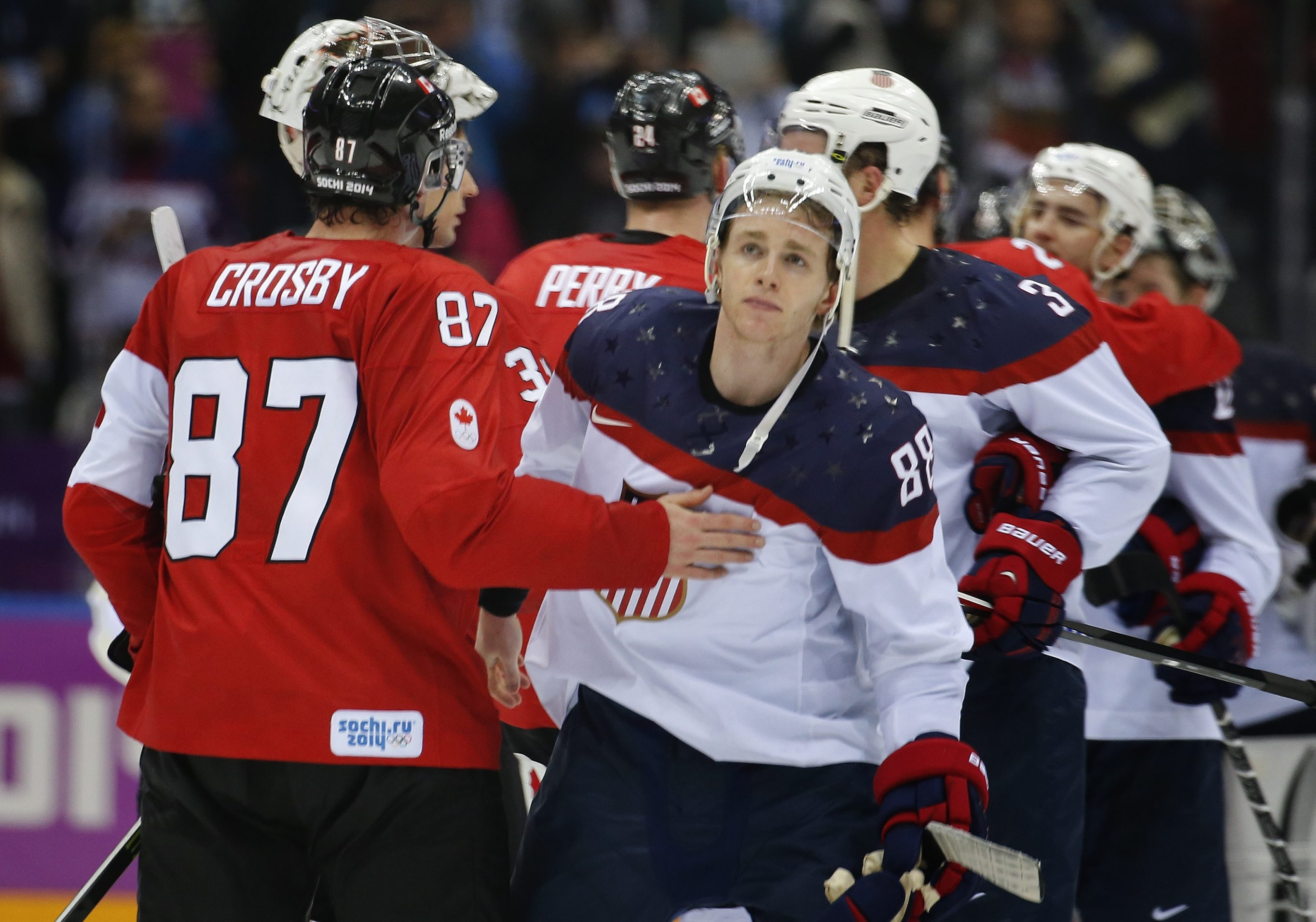 Canada's Sidney Crosby consoles Team USA forward Patrick Kane after Canada won, 1-0, in their men's semifinal hockey game Friday in Sochi, Russia. The U.S. hockey team plays Finland at 10 a.m. today for a bronze medal.