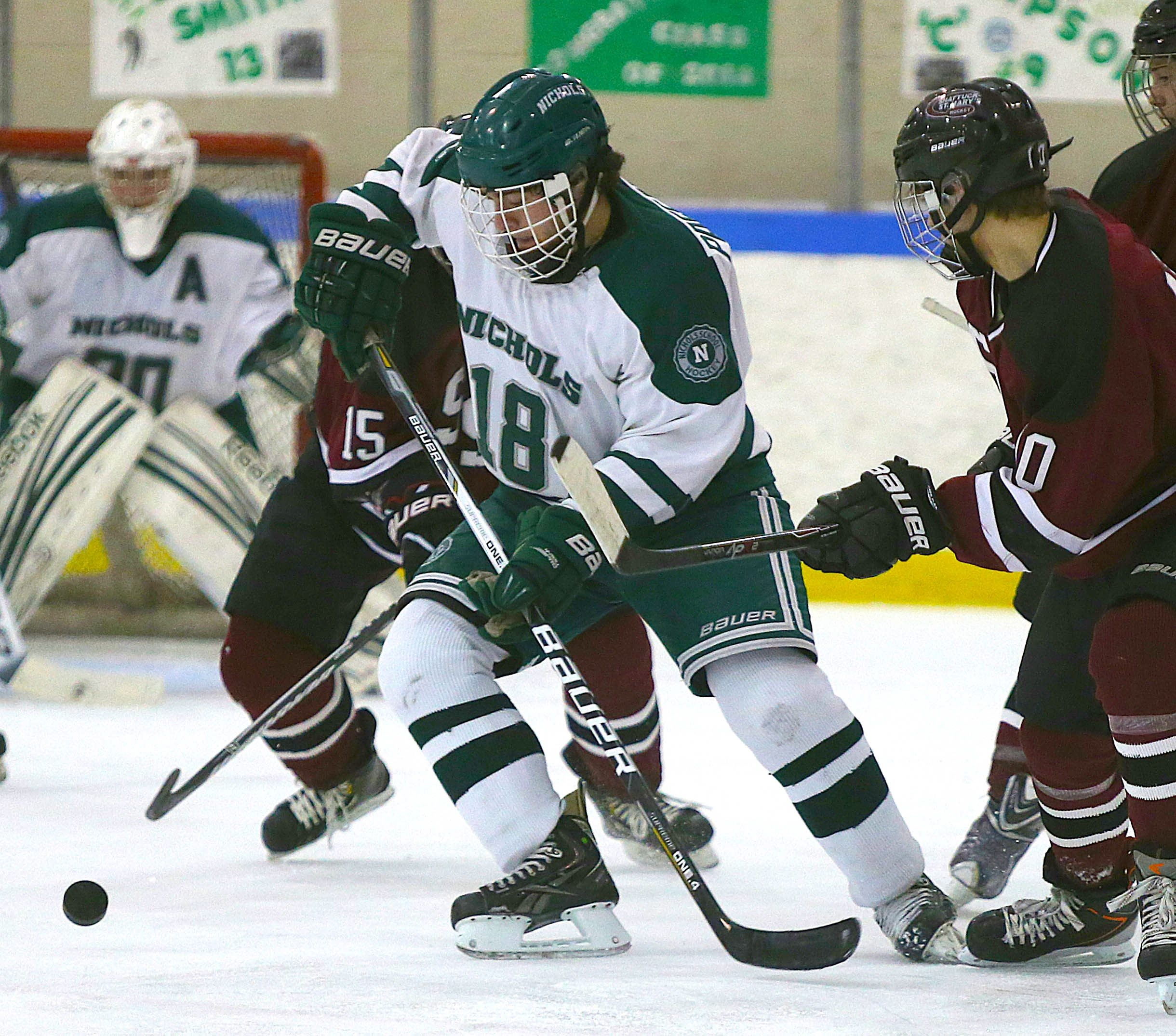 Nichols' Nick Passafiume (18) controls the puck against Shattuck-St. Mary's. Nichols dropped a 3-2 decision at home.