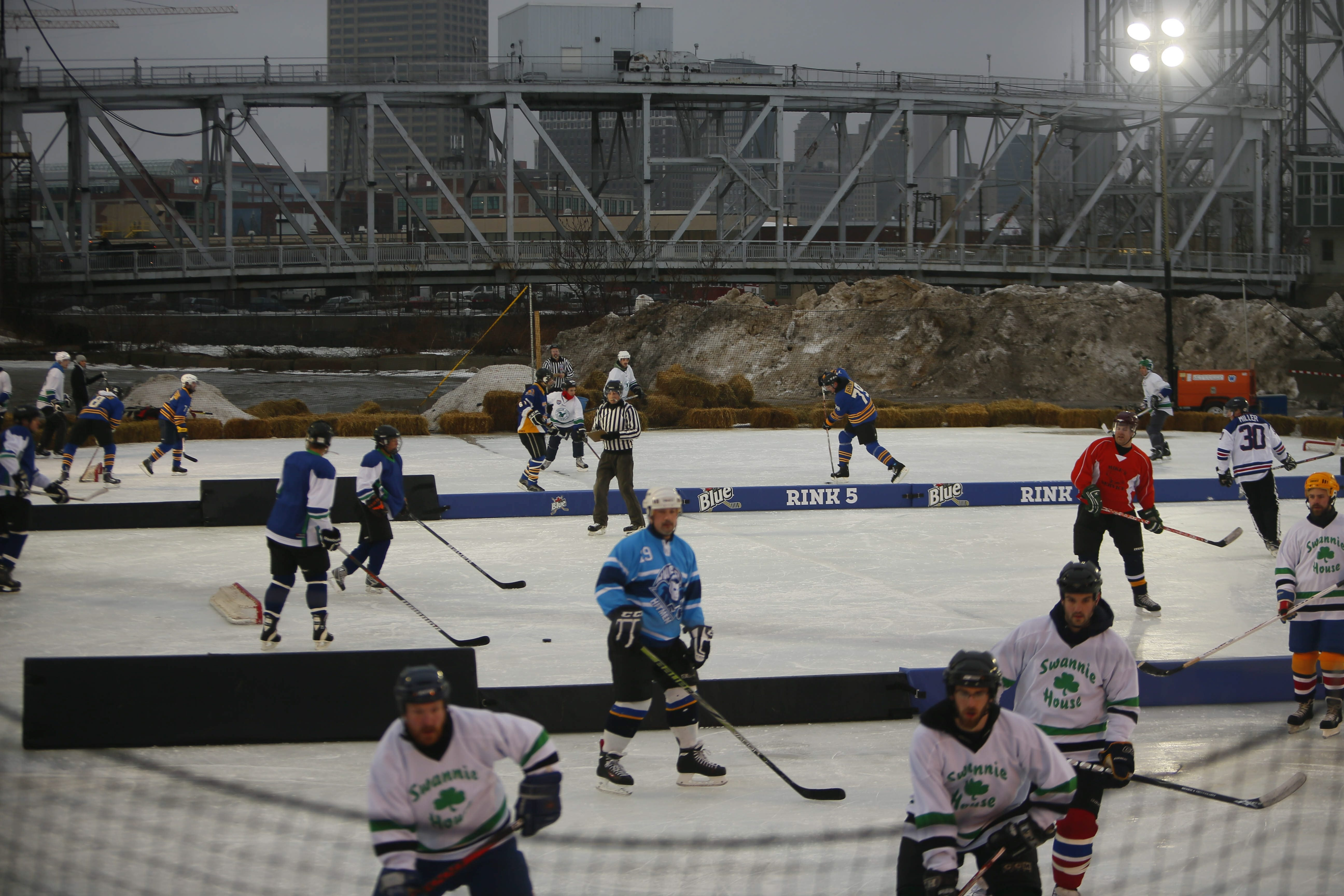 With the Michigan Avenue bridge as a backdrop, the first games of the  Labatt Blue Pond Hockey Tournament begin at Buffalo RiverWorks on Friday. See a photo gallery at BuffaloNews.com.