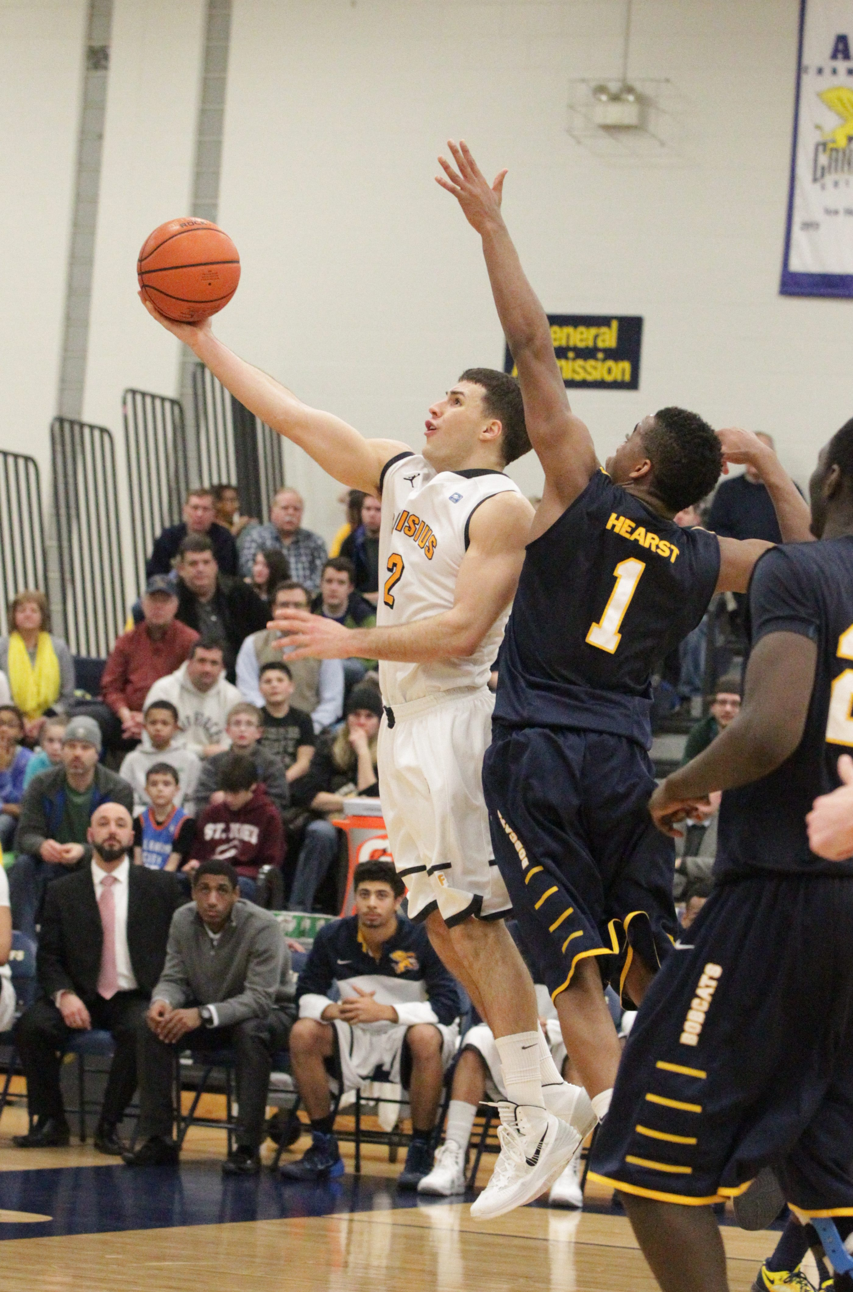 Canisius' Billy Baron gets around Quinnipiac's Zaid Hearst for two points in the second half.