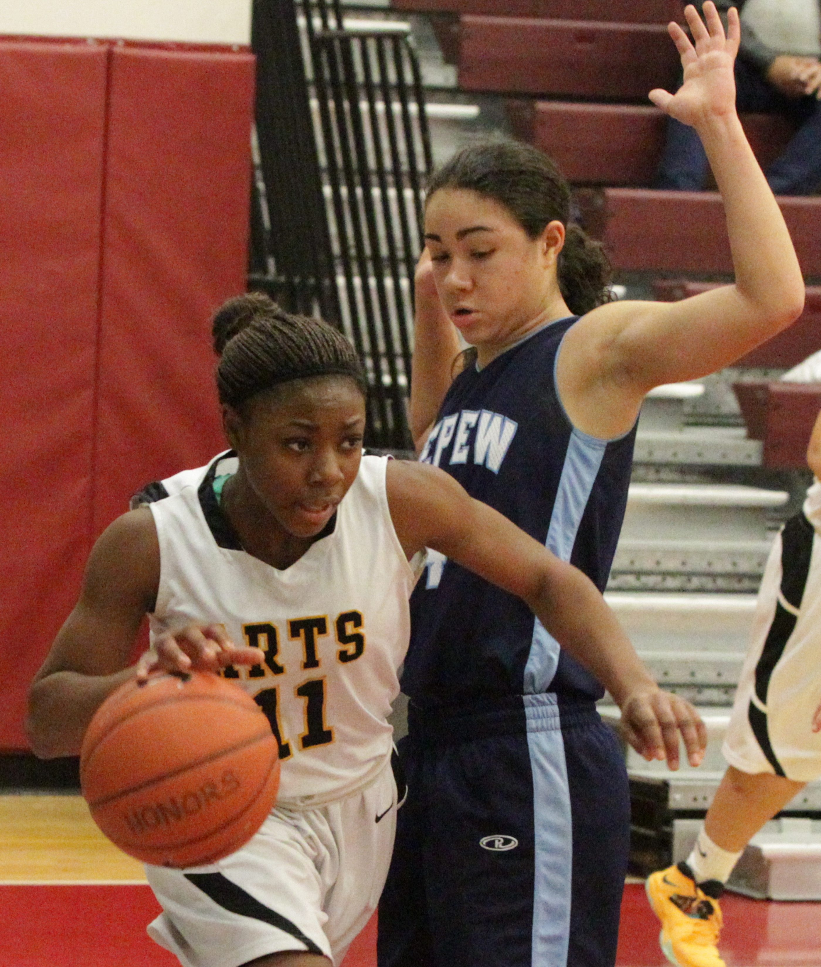 Depew's Idalis Santiago battles with Buffalo Arts' Alexis Campbell in a quarterfinal win for the Cavaliers.