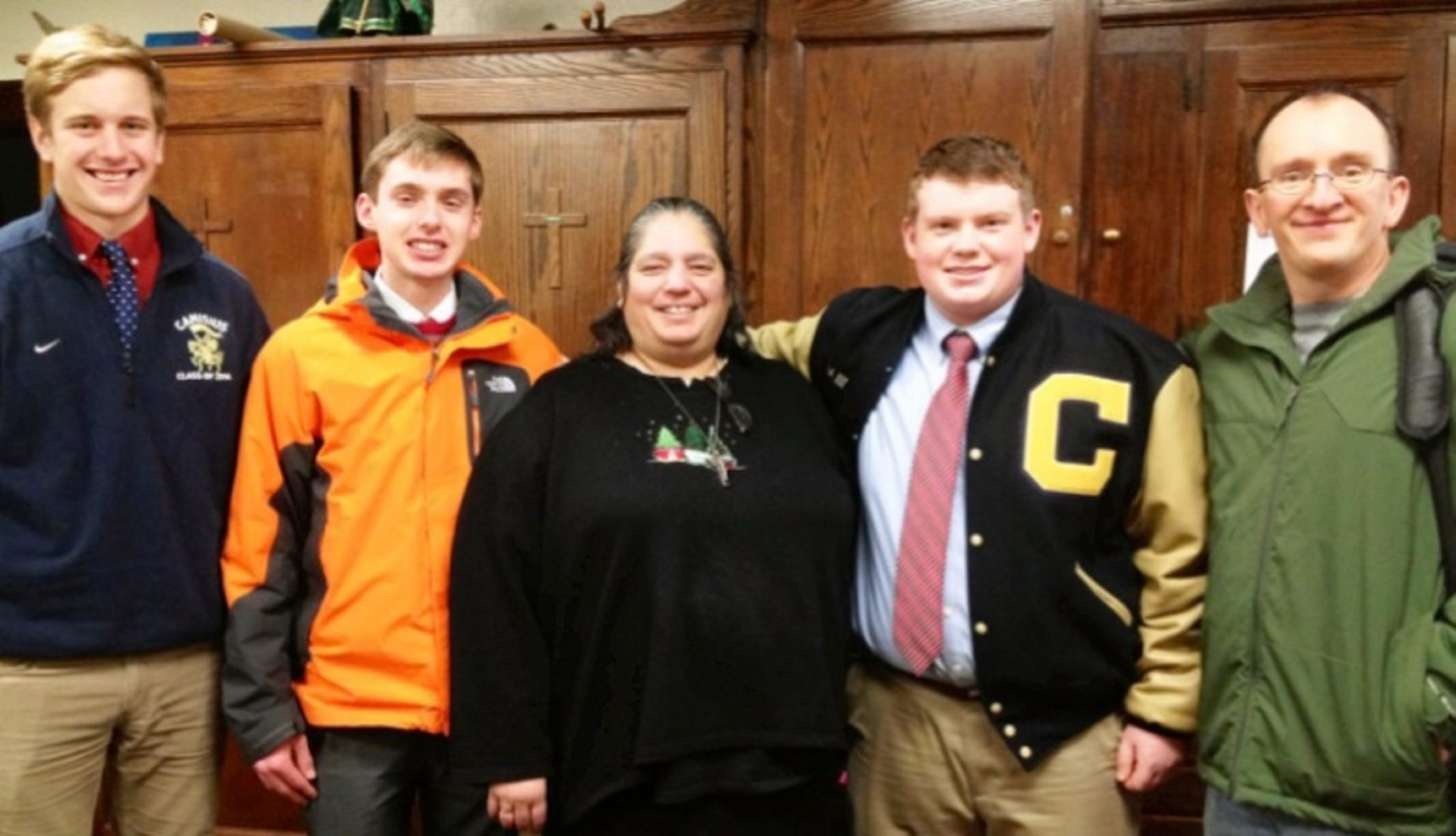From left, Canisius students John Corr, senior; Bryan Karas, junior;  Amy (a worker at St. Luke's whose last name was not provided), Frank Fialkewicz III, junior; and Ron Aherns.