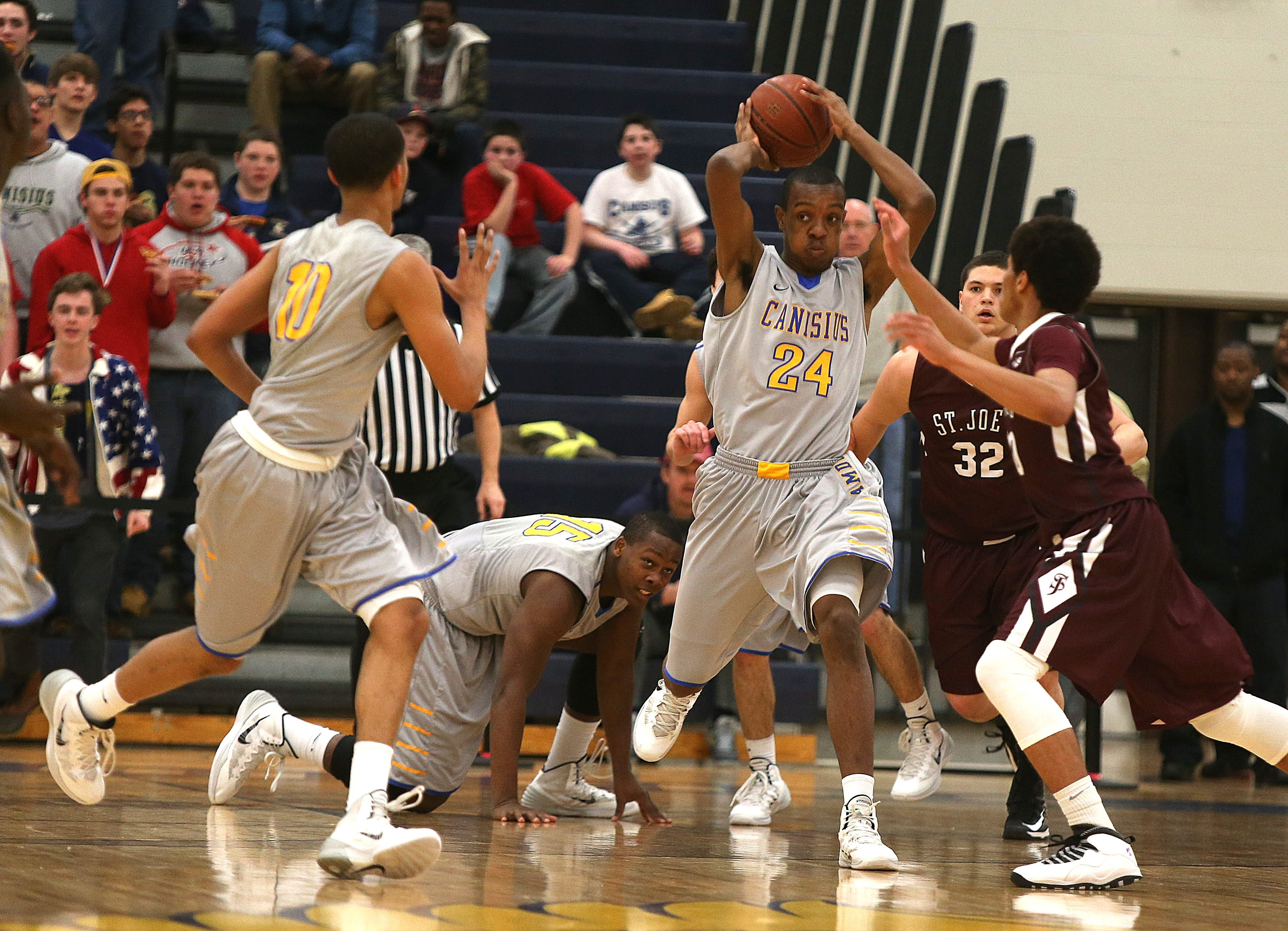 Stafford Trueheart (24) and Howard Washington (10) are star performers for a team that has won a Canisius High record 22 games.
