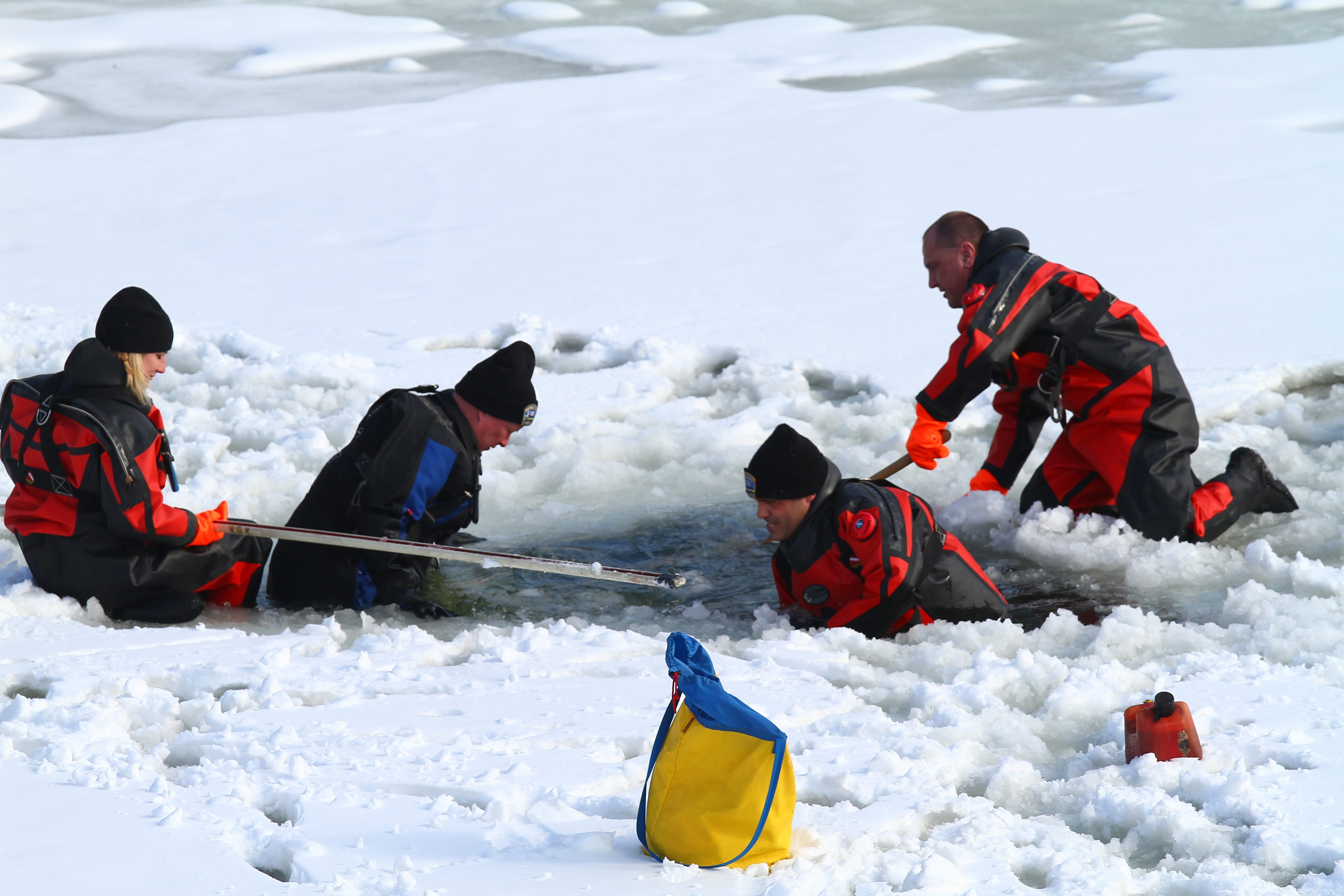 The Buffalo Police Underwater Recovery Team cuts holes in the ice to control potential ice jams and prevent flooding.