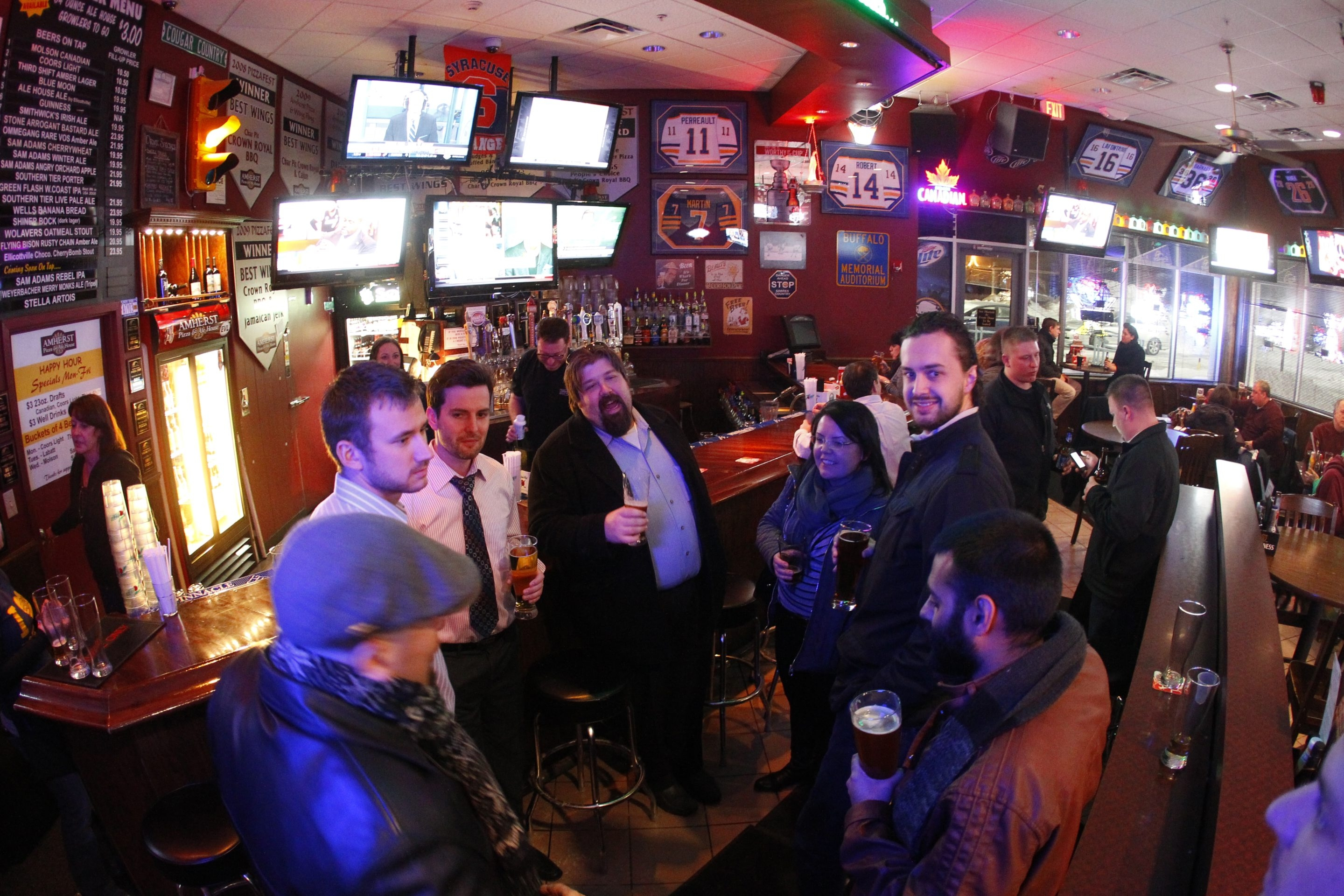 Patrons enjoy the drinks and conversation at the Amherst Ale House.