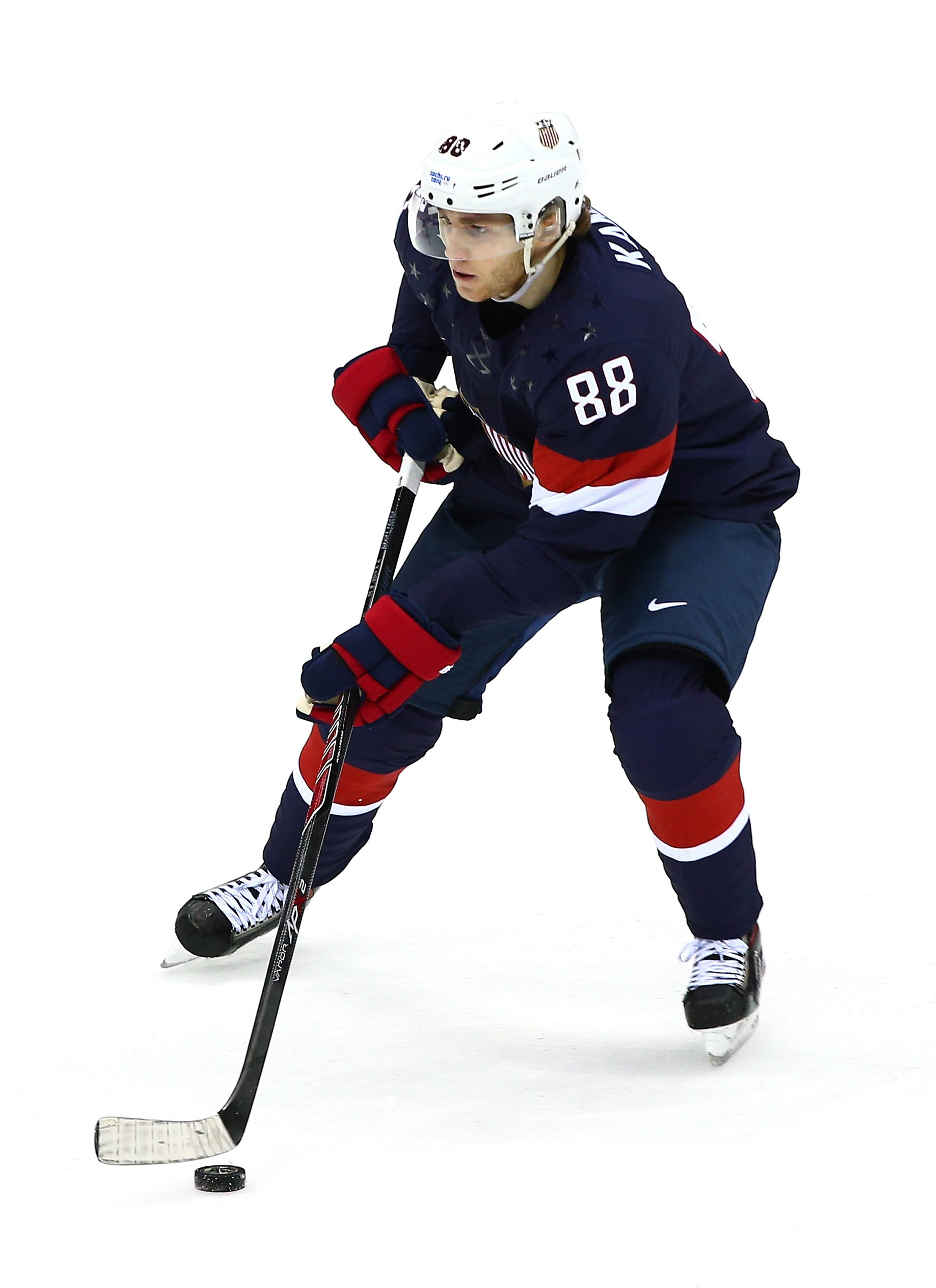 Patrick Kane controls the puck for Team USA against Russia during a preliminary game of the Winter Olympics at Bolshoy Ice Dome in Sochi, Russia.