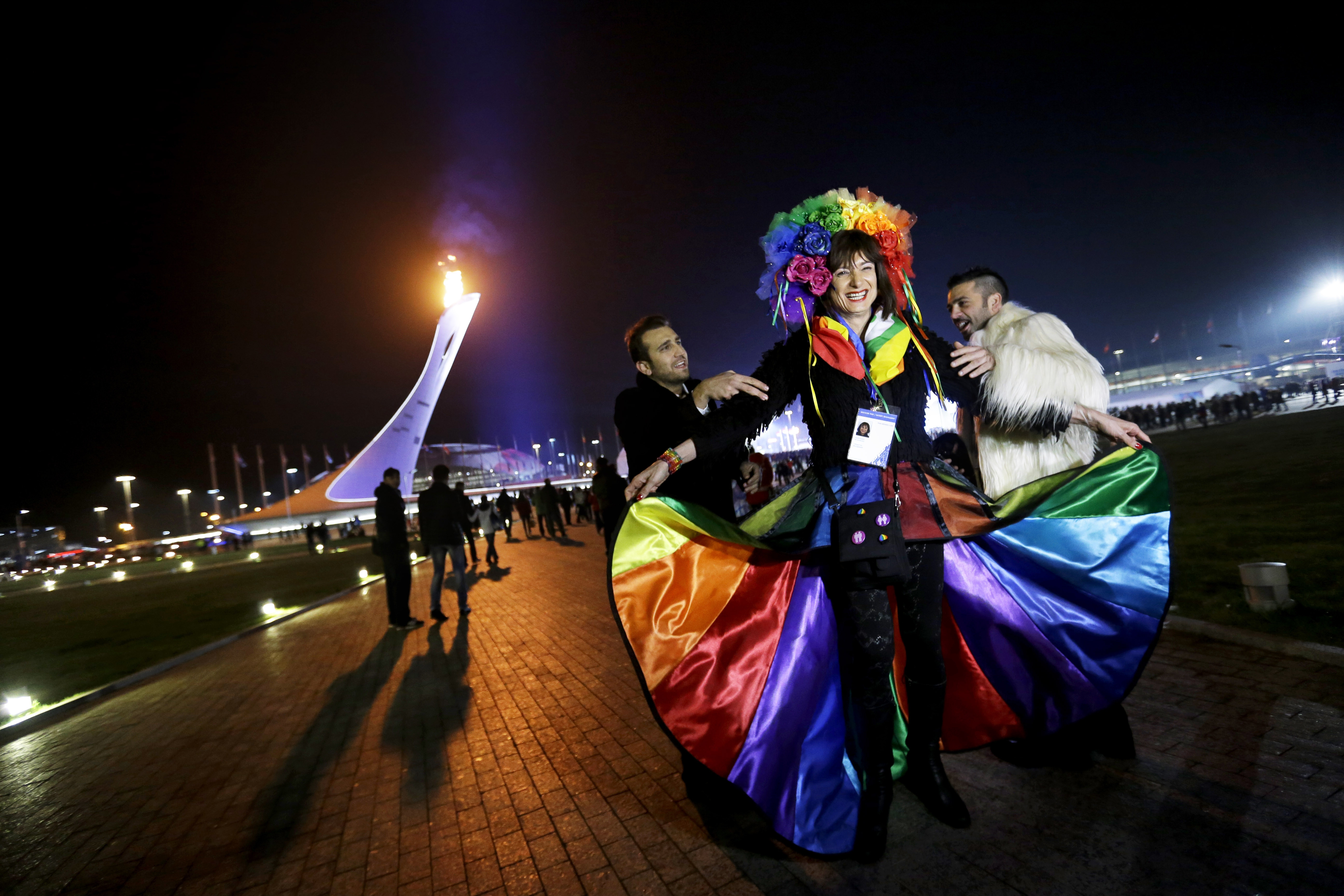 Vladimir Luxuria, center, a former lawmaker in Italy and a crusader for transgender rights, wore a rainbow cape while trying to enter Shayba Arena in Sochi, Russia.
