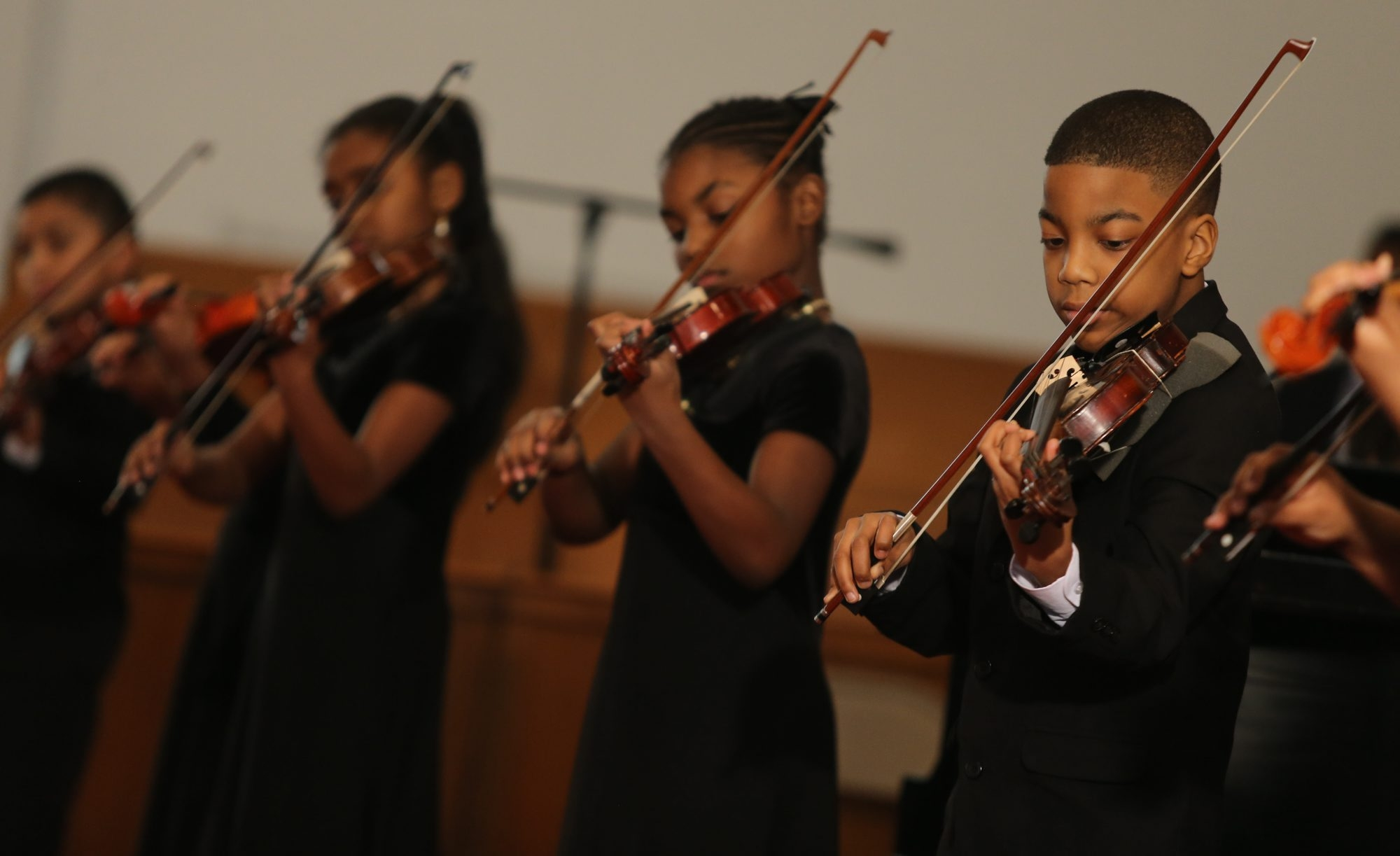 Students perform on violin during the Henri L. Muhammad School of Music's Voice of My Heart Recital Series at the First Shiloh Baptist Church in Buffalo on Sunday.
