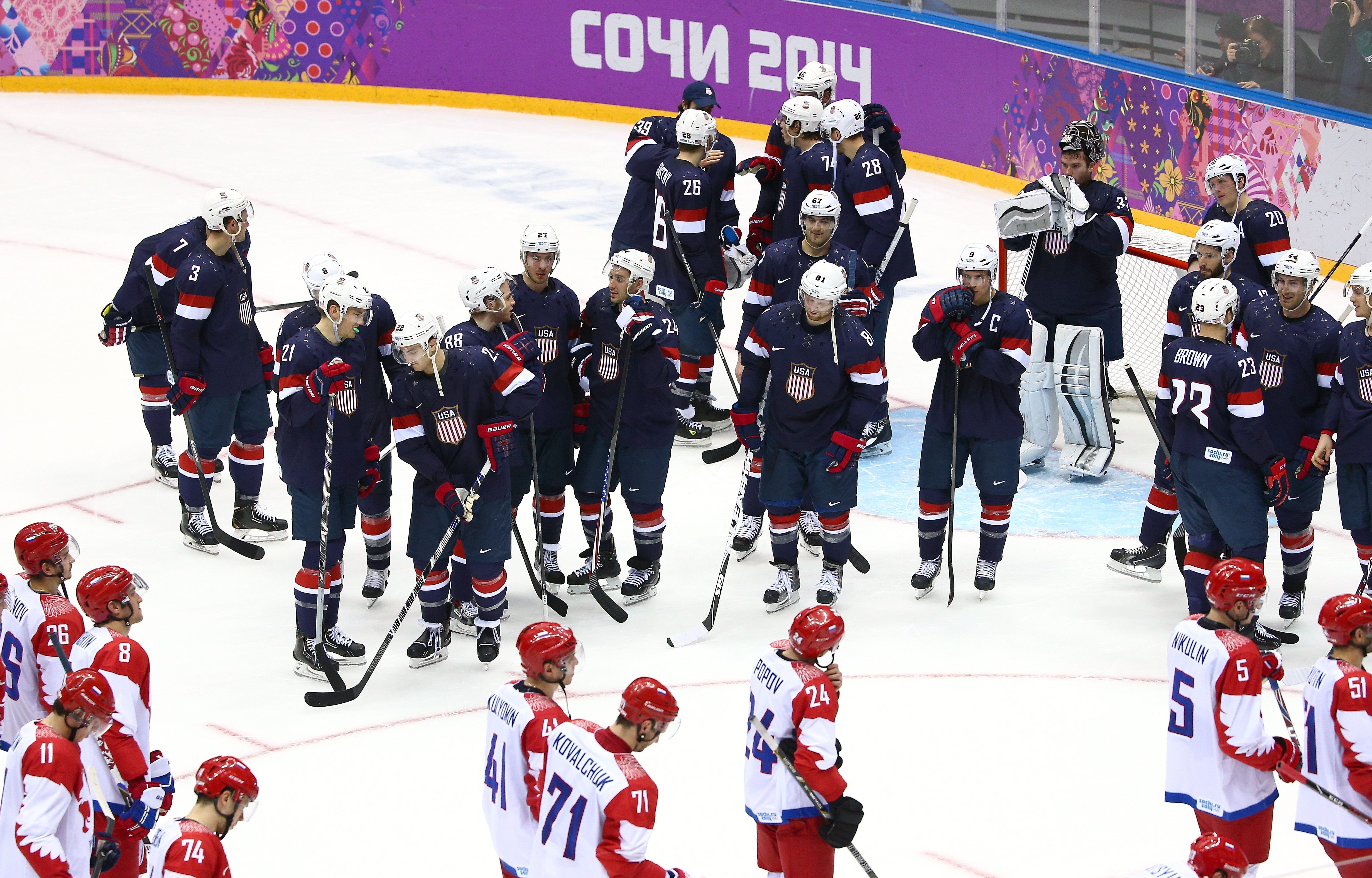 The U.S. men's hockey team celebrates after defeating Russia in a shootout in an intense game that made a powerful argument for keeping NHL stars in the Winter Olympics.