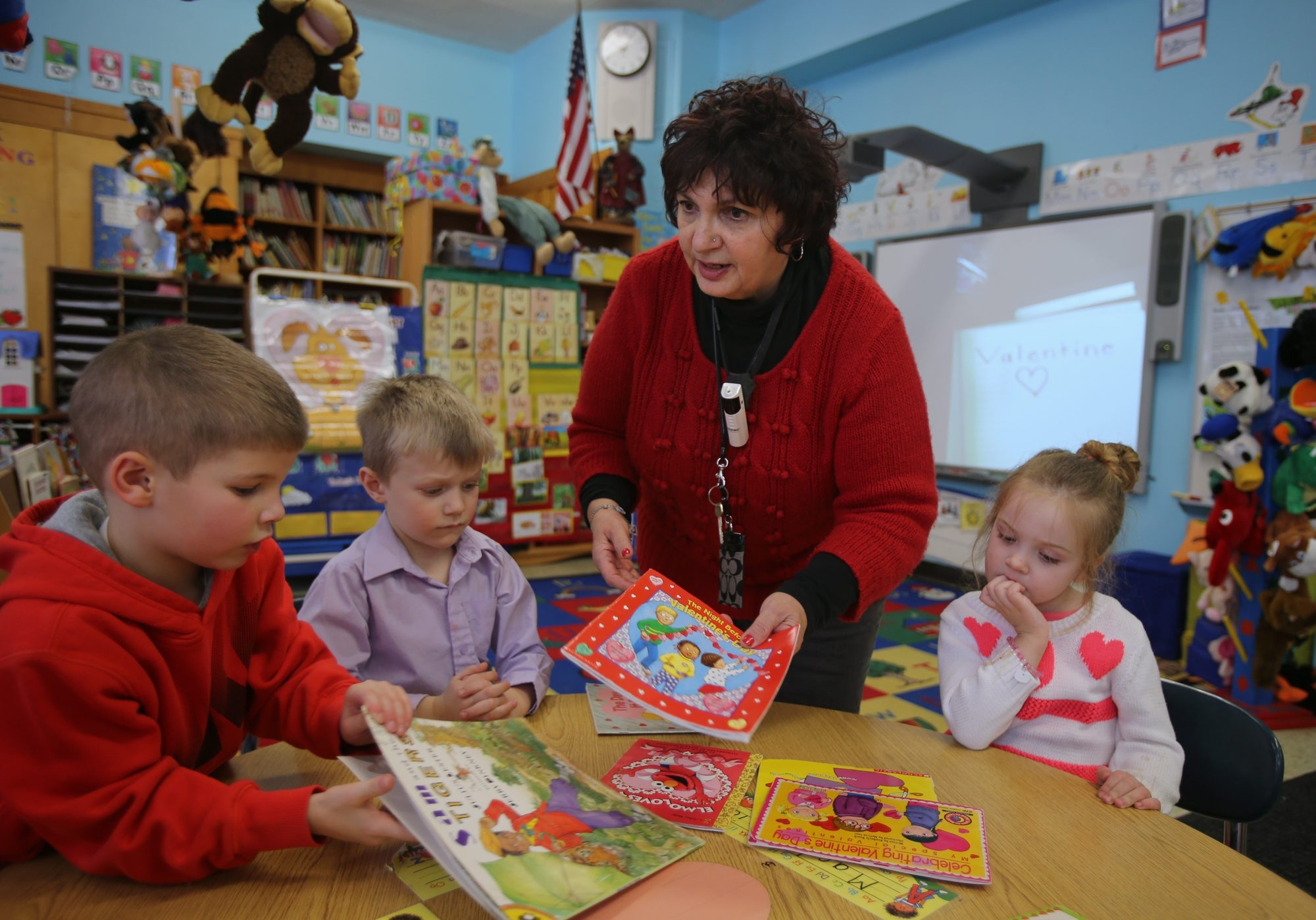 Ms. Joan Pawlukovich works with students in her pre-K class at the 79th St. Elementary School in Niagara Falls, Friday.